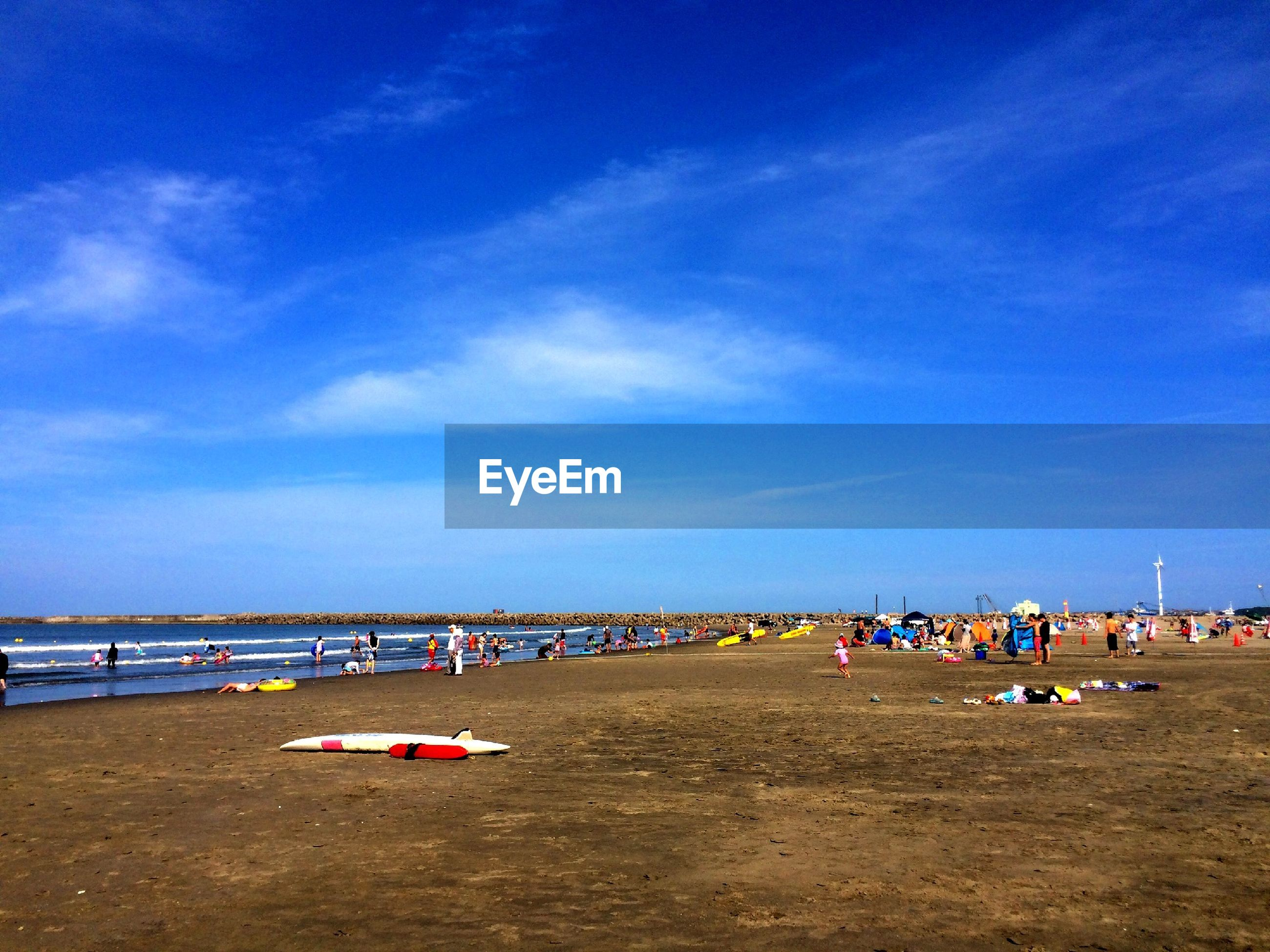 beach, sand, sea, water, shore, blue, sky, transportation, vacations, tranquility, nautical vessel, large group of people, tranquil scene, horizon over water, nature, incidental people, mode of transport, scenics, day, cloud - sky