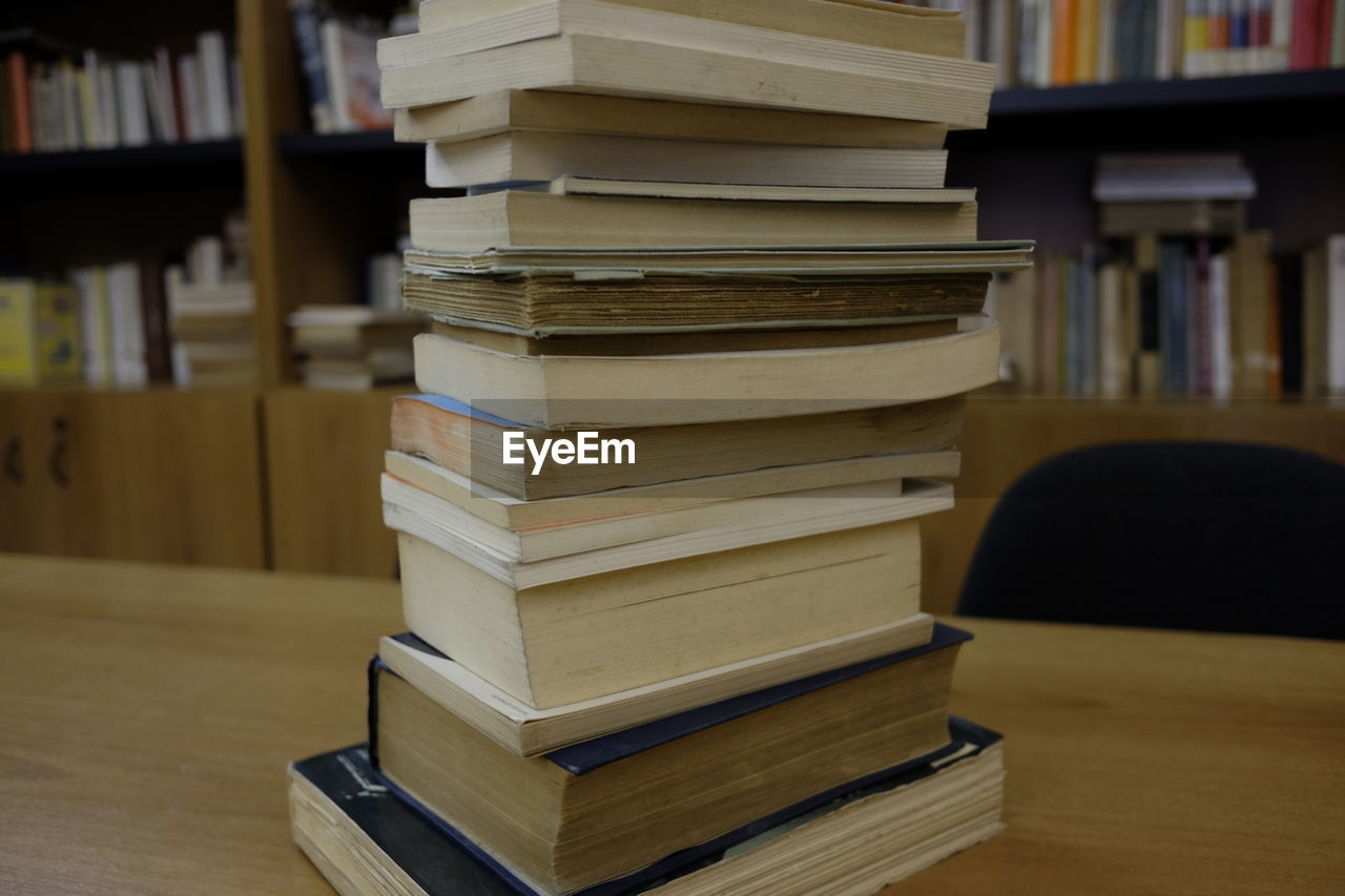 book, education, stack, indoors, bookshelf, learning, library, literature, bookstore, large group of objects, wisdom, table, knowledge, research, shelf, no people, focus on foreground, studying, close-up, archives, day