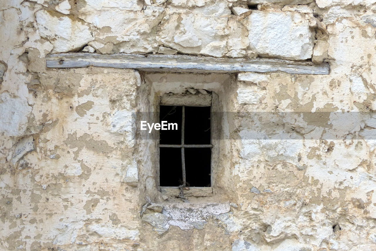 architecture, built structure, window, building exterior, wall - building feature, old, building, no people, day, wall, abandoned, weathered, history, low angle view, the past, outdoors, damaged, stone wall, textured, run-down, ruined
