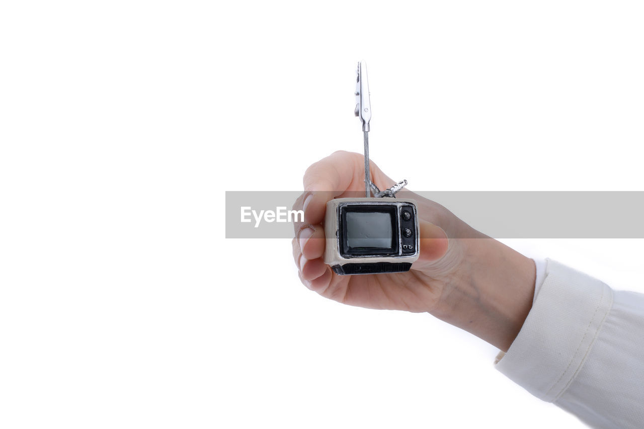human hand, hand, human body part, holding, white background, one person, studio shot, copy space, smart phone, wireless technology, technology, communication, indoors, mobile phone, portable information device, connection, real people, unrecognizable person, using phone, finger