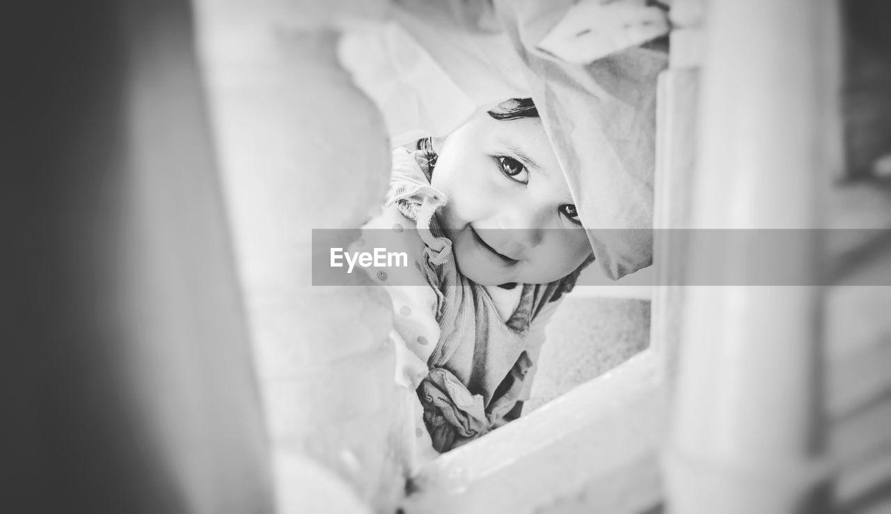Close-Up Of Toddler Girl Looking At Camera