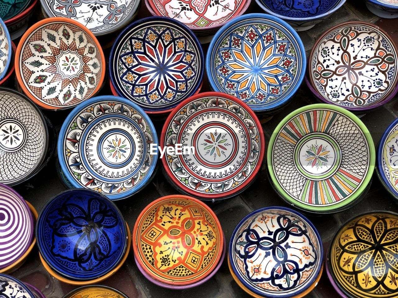 Full frame shot of patterned pottery for sale at market stall