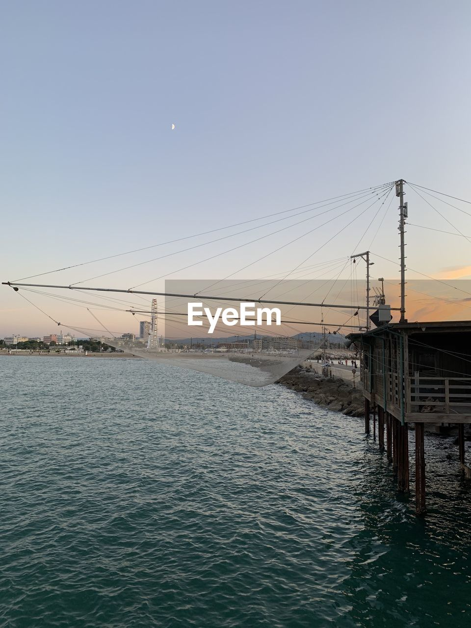 sky, water, built structure, architecture, nature, waterfront, clear sky, connection, sea, no people, beauty in nature, transportation, bridge, building exterior, scenics - nature, sunset, outdoors, copy space, bridge - man made structure, electricity