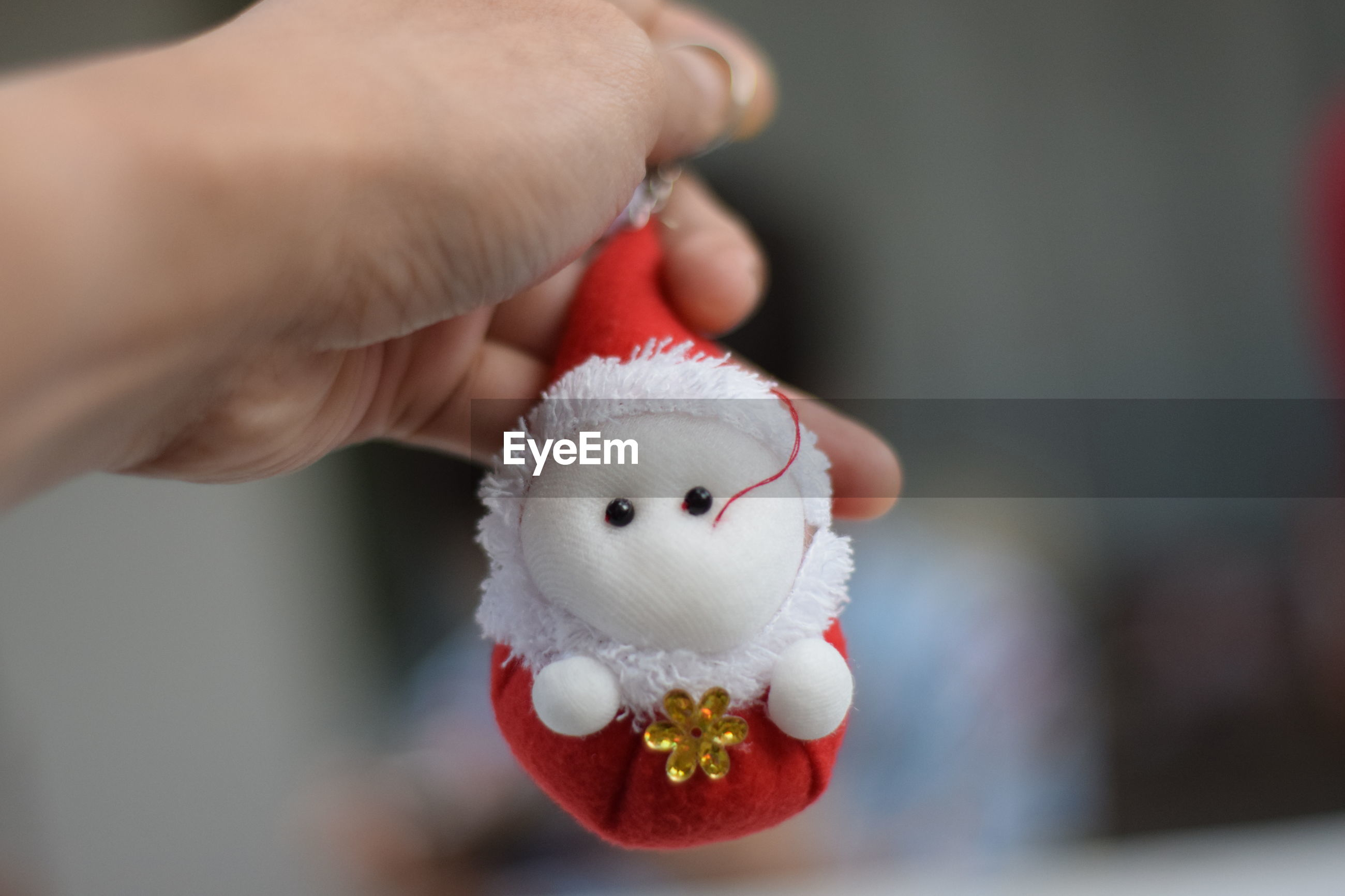 Cropped hand holding christmas decoration