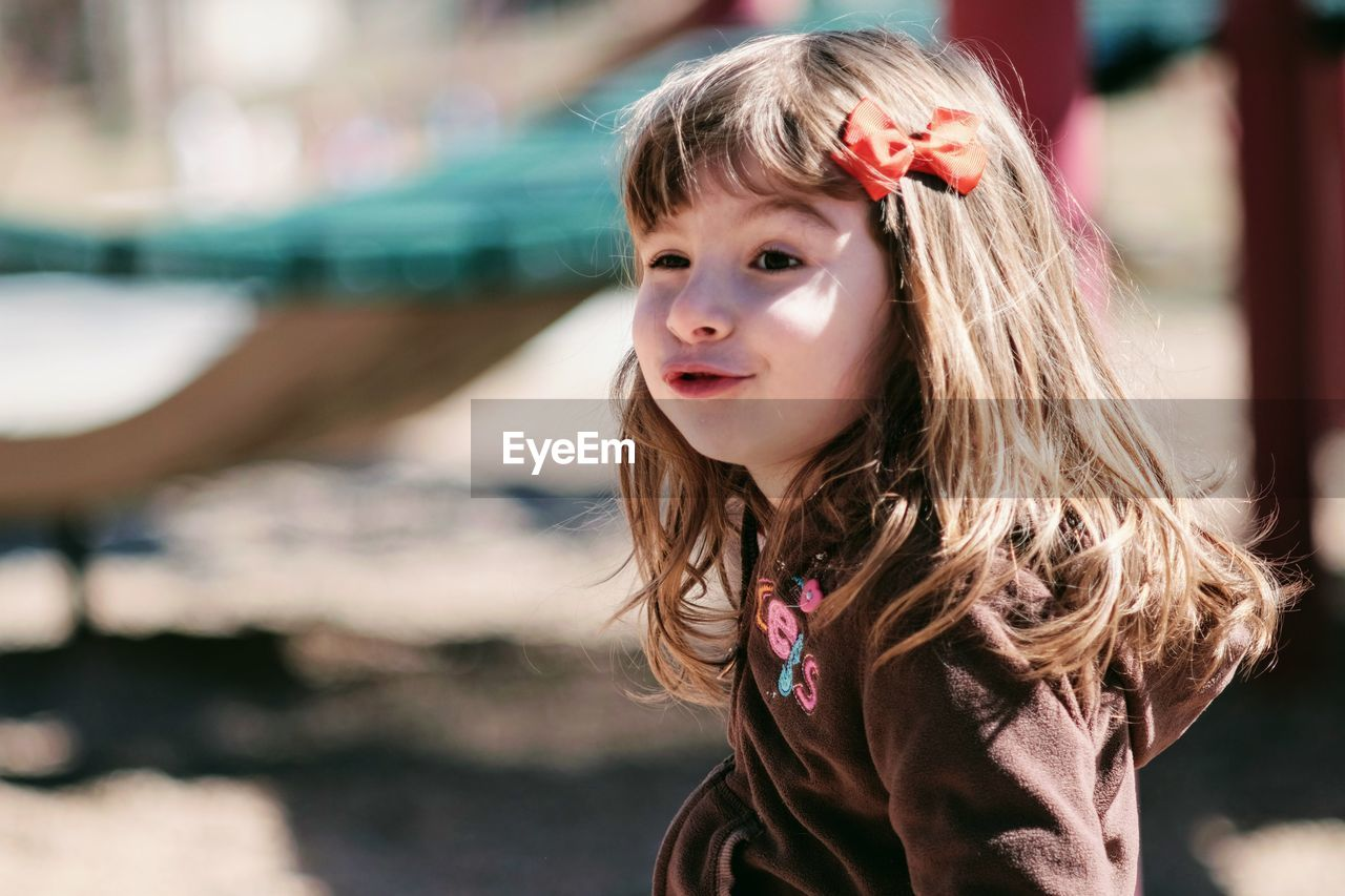 Close-Up Of Innocent Girl At Playground