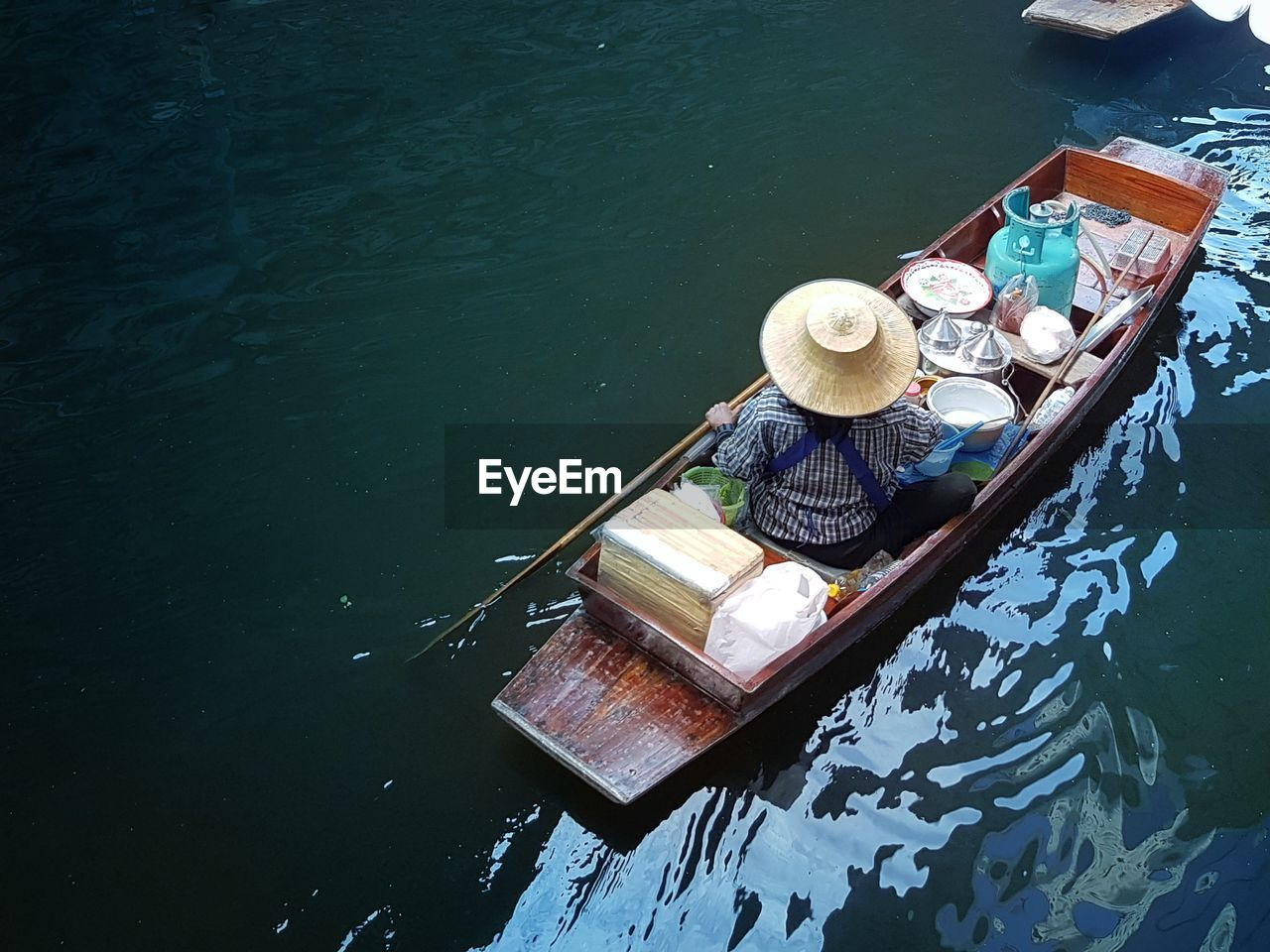 High Angle View Of Vendor Sailing In Canal