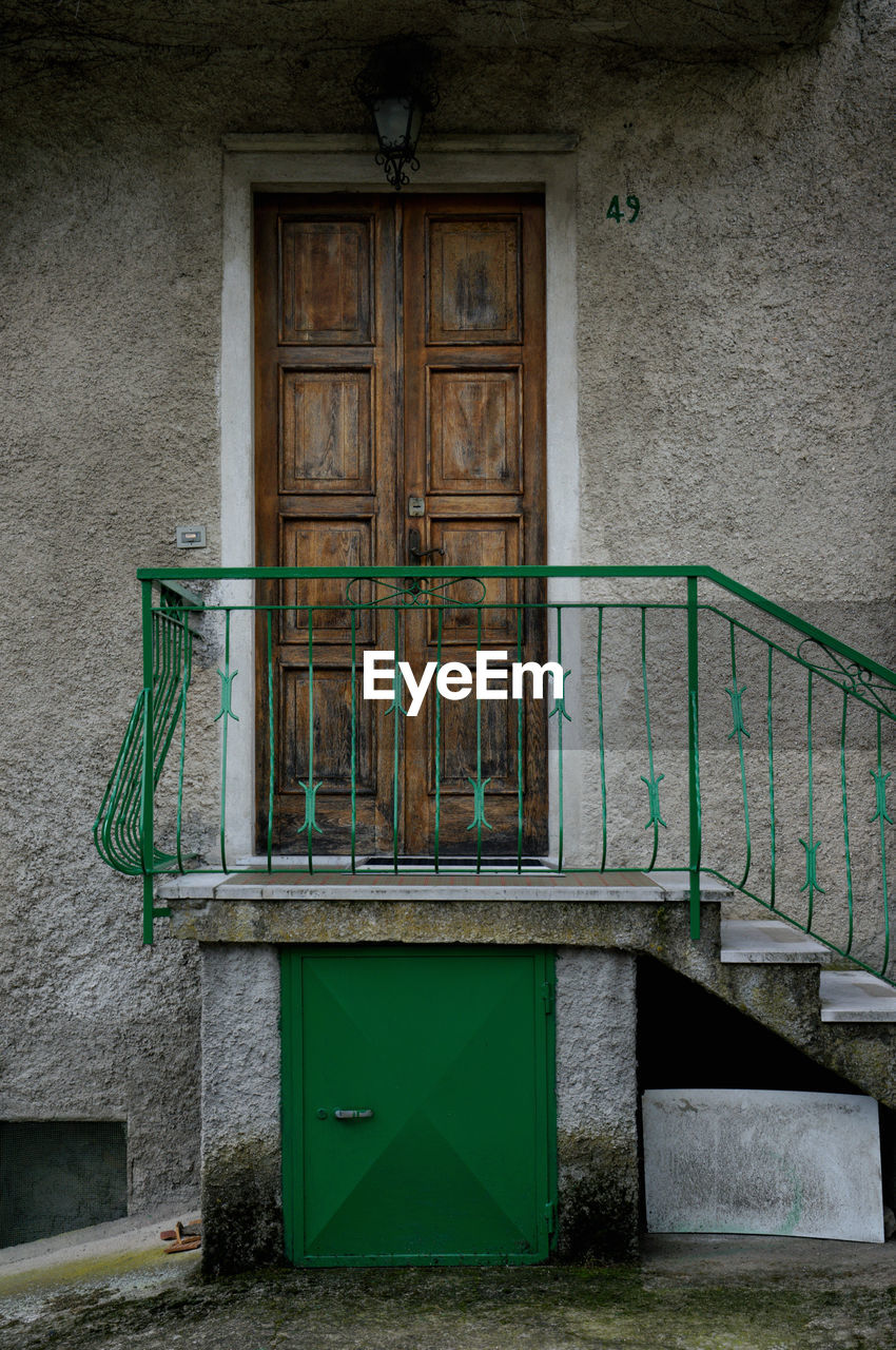 door, architecture, built structure, entrance, green color, building exterior, no people, house, day, steps, doorway, outdoors, entry