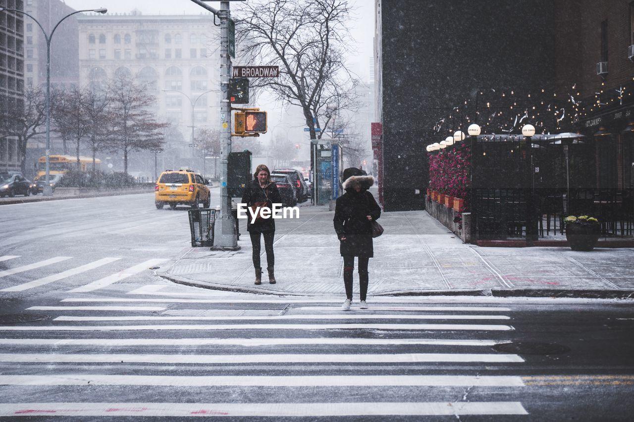 PEOPLE ON STREET IN WINTER