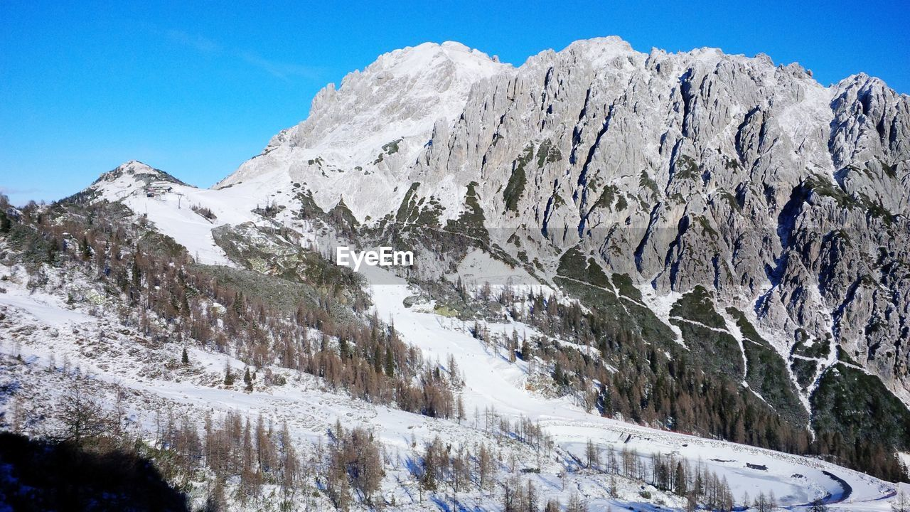 snow, mountain, cold temperature, winter, beauty in nature, sky, scenics - nature, tranquil scene, tranquility, nature, environment, no people, mountain range, day, snowcapped mountain, non-urban scene, rock, landscape, idyllic, outdoors, mountain peak, formation, range