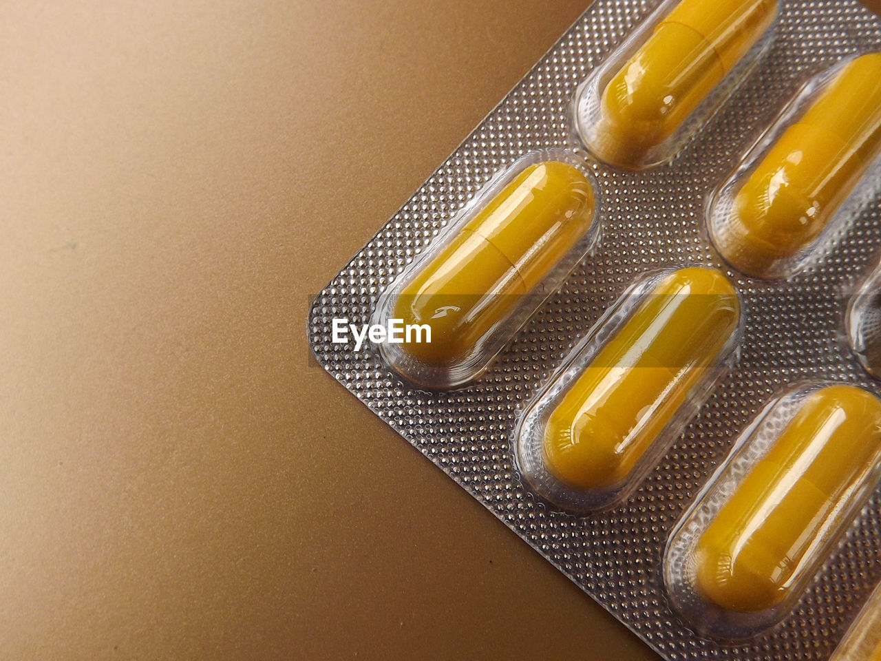 healthcare and medicine, pill, medicine, capsule, nutritional supplement, prescription medicine, indoors, blister pack, vitamin, close-up, no people, yellow, dose, antibiotic, day