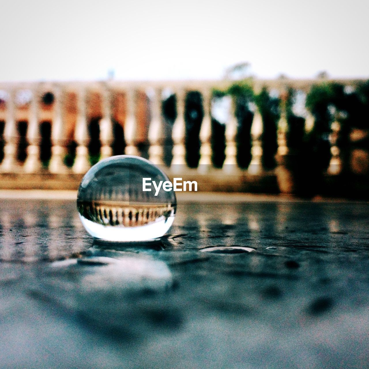 Water drop with reflection of railing