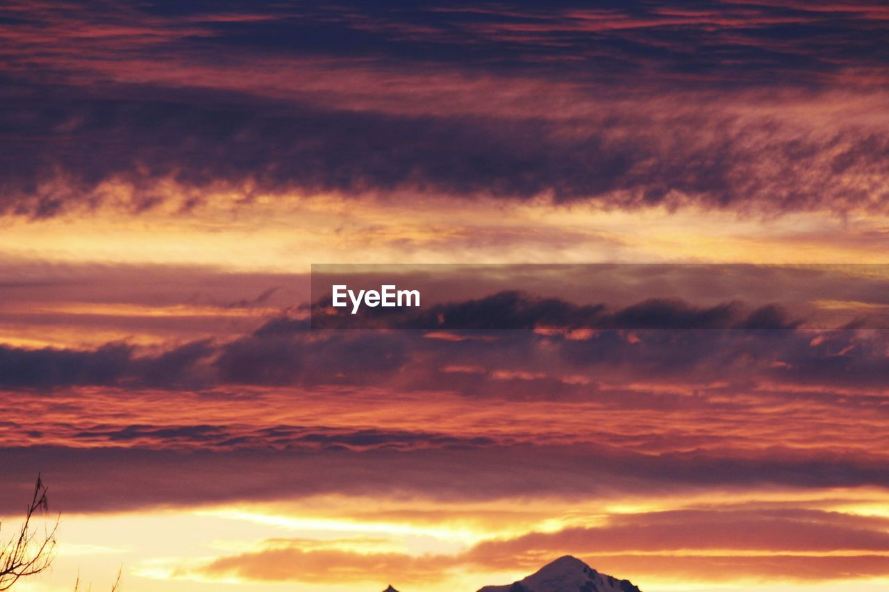 sunset, beauty in nature, tranquility, nature, scenics, cloud - sky, dramatic sky, tranquil scene, sky, cloudscape, atmospheric mood, idyllic, orange color, no people, sky only, awe, backgrounds, outdoors, day