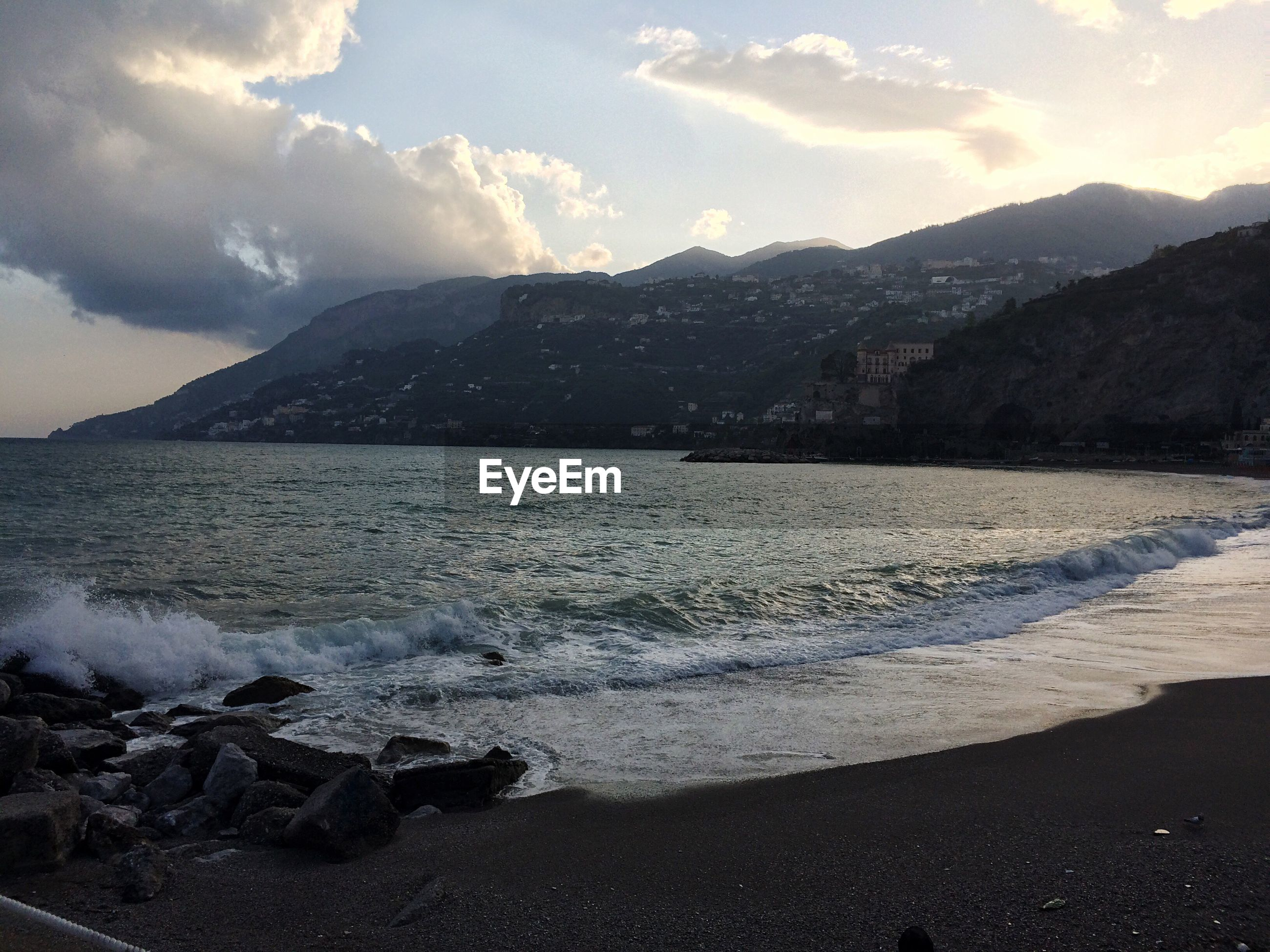 SCENIC VIEW OF SEA AND MOUNTAINS