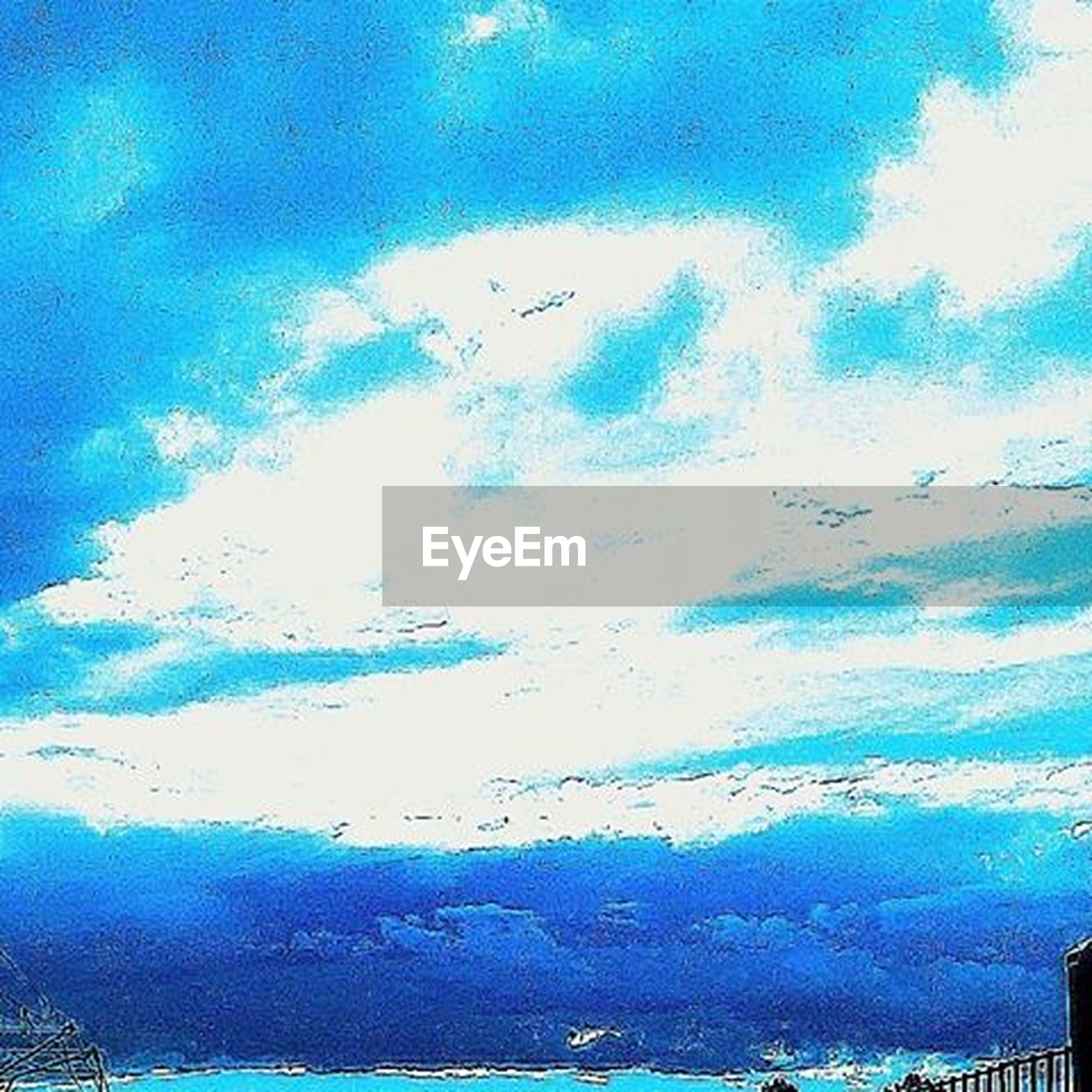 blue, sky, cloud - sky, flying, cloud, beauty in nature, nature, bird, sea, scenics, low angle view, tranquility, water, cloudy, tranquil scene, day, built structure, outdoors, no people, animal themes