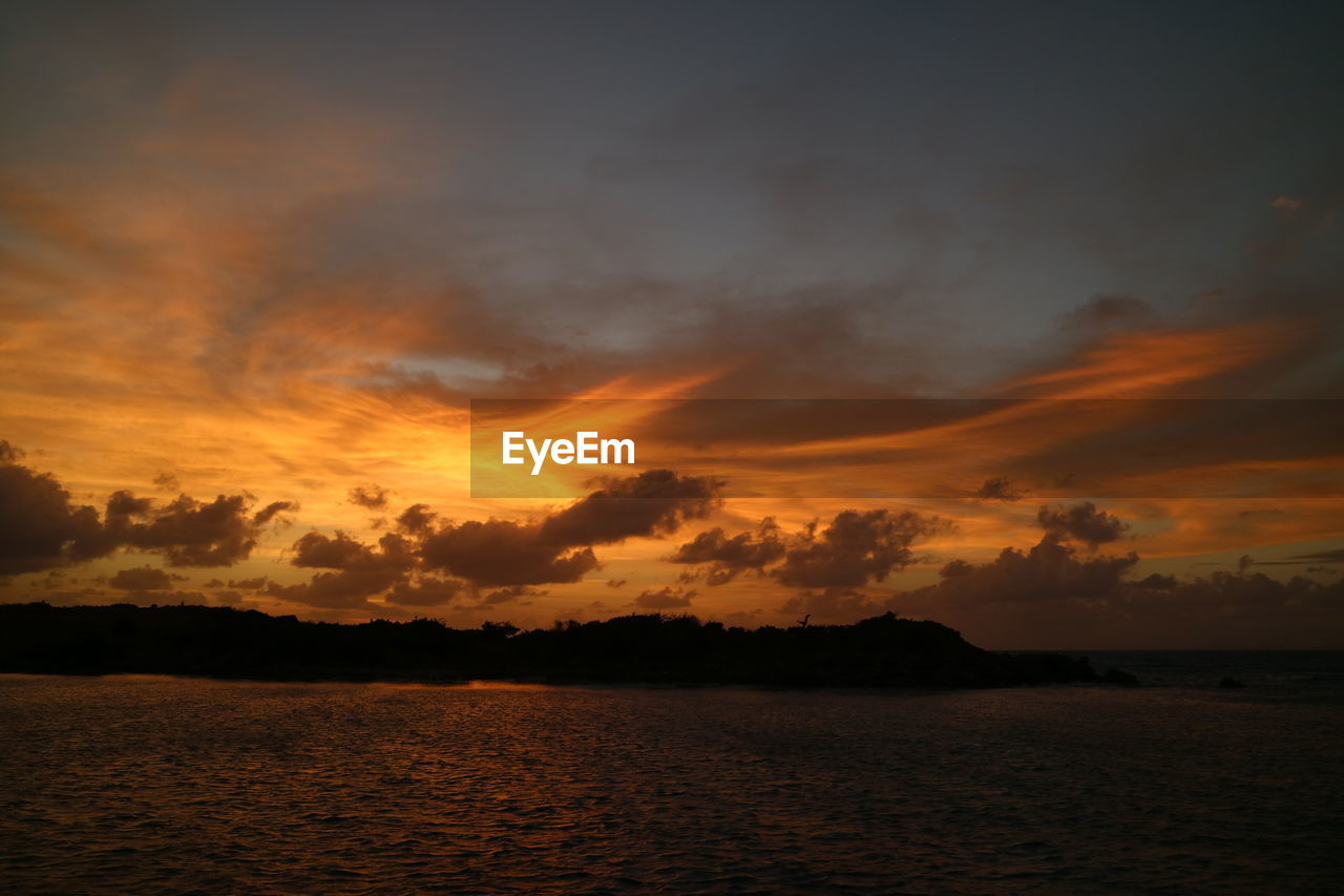 sky, sunset, cloud - sky, tranquility, scenics - nature, beauty in nature, tranquil scene, water, waterfront, sea, orange color, no people, nature, idyllic, silhouette, non-urban scene, outdoors, dramatic sky, dusk