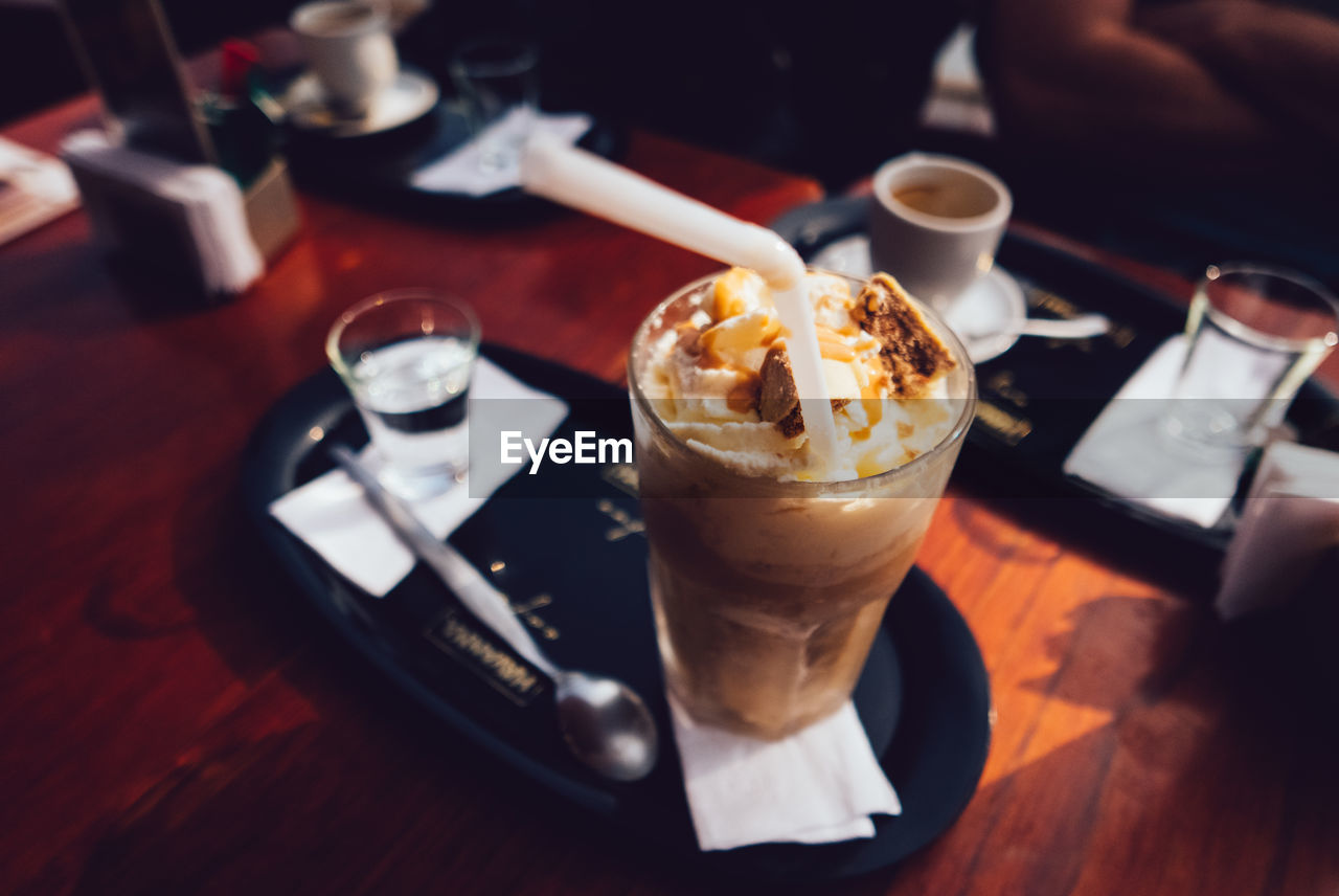 High Angle View Of Cold Coffee Served On Table