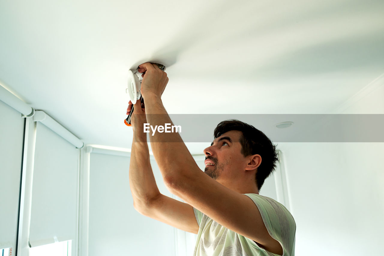 Low angle view of man working at home