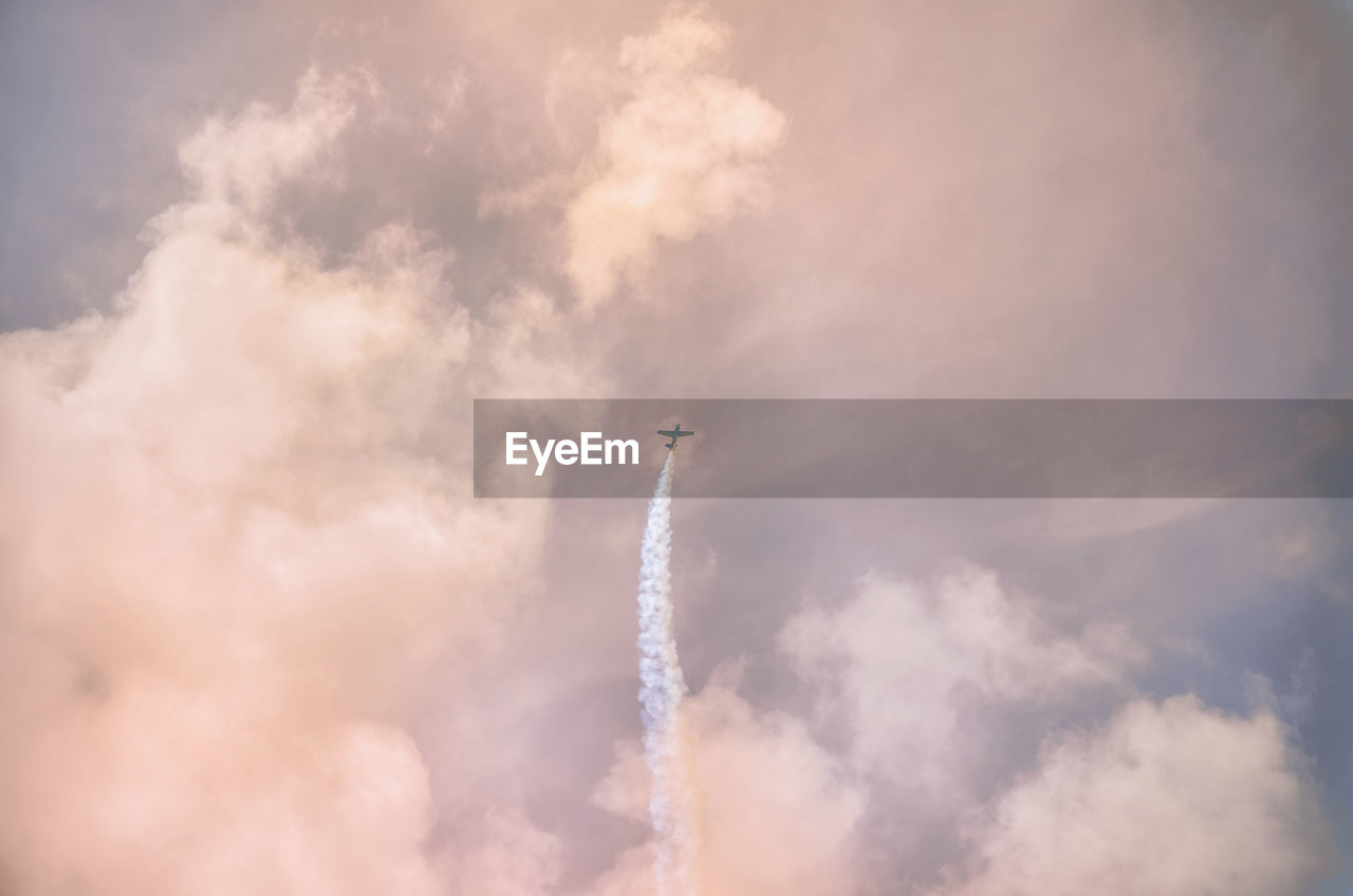 cloud - sky, sky, air vehicle, low angle view, smoke - physical structure, airplane, vapor trail, transportation, flying, mode of transportation, nature, on the move, no people, day, speed, motion, airshow, performance, fighter plane, outdoors, plane, aerospace industry, aerobatics