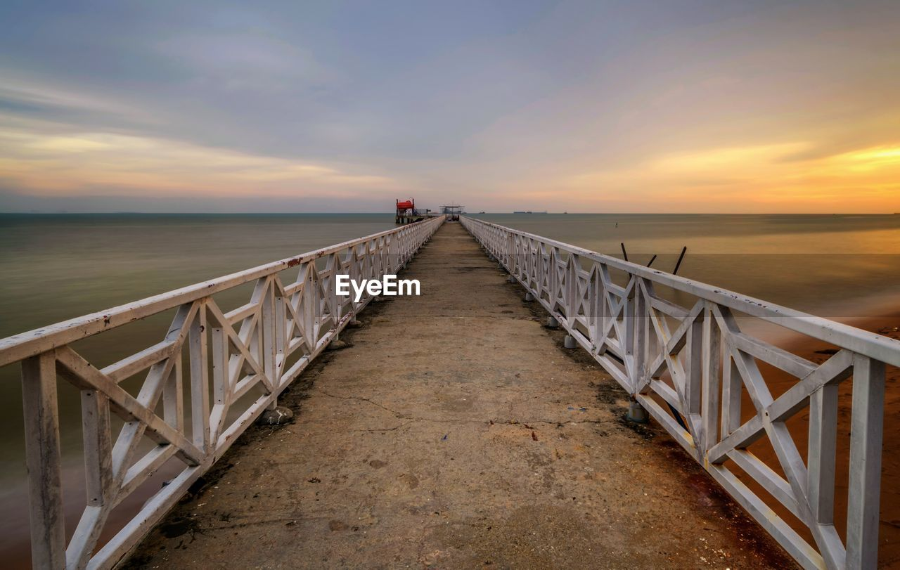 sky, sunset, sea, water, scenics - nature, direction, horizon, beauty in nature, the way forward, railing, horizon over water, tranquility, tranquil scene, diminishing perspective, cloud - sky, nature, idyllic, orange color, pier, outdoors, long