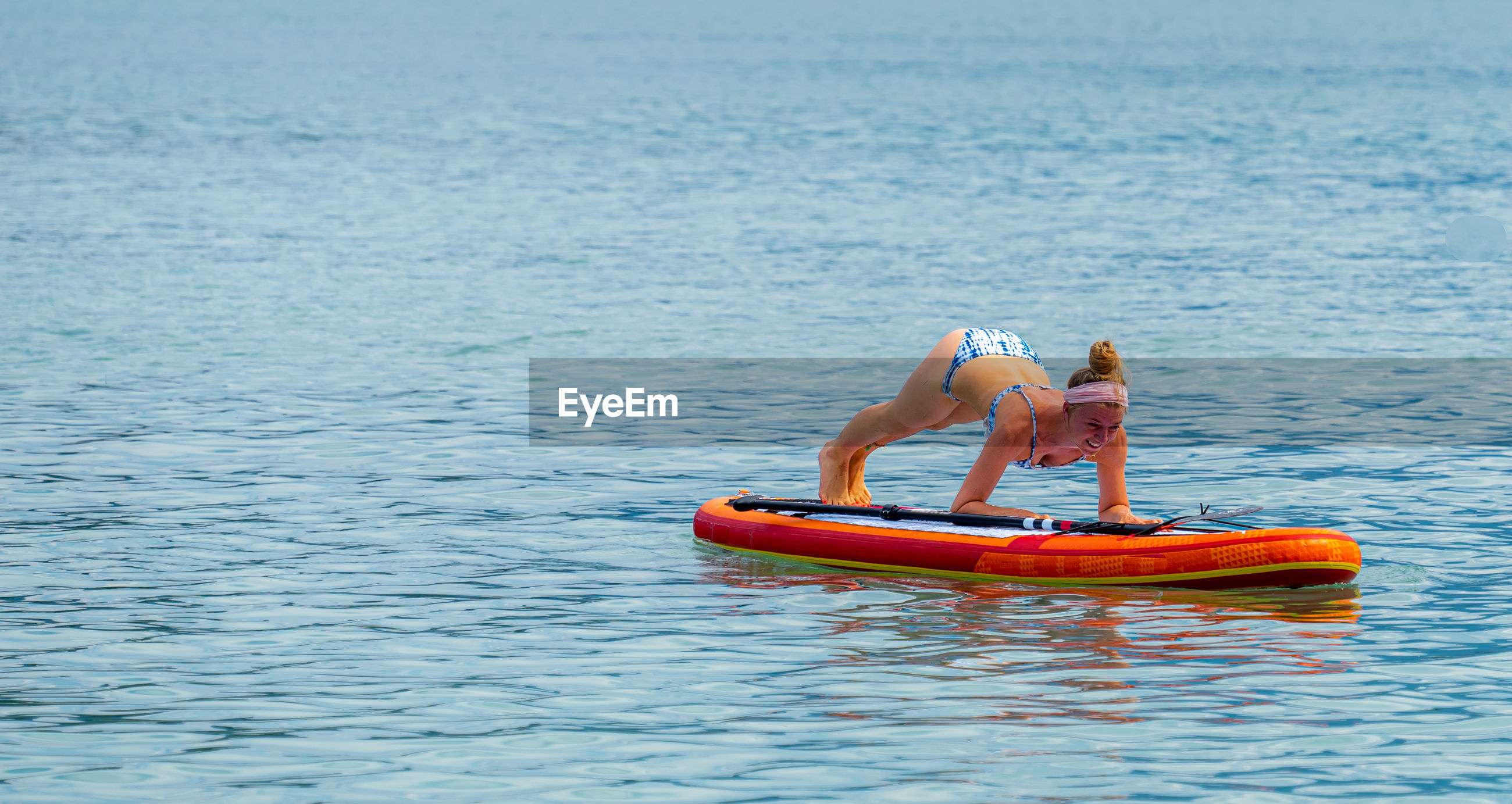 Woman exercising on paddleboard