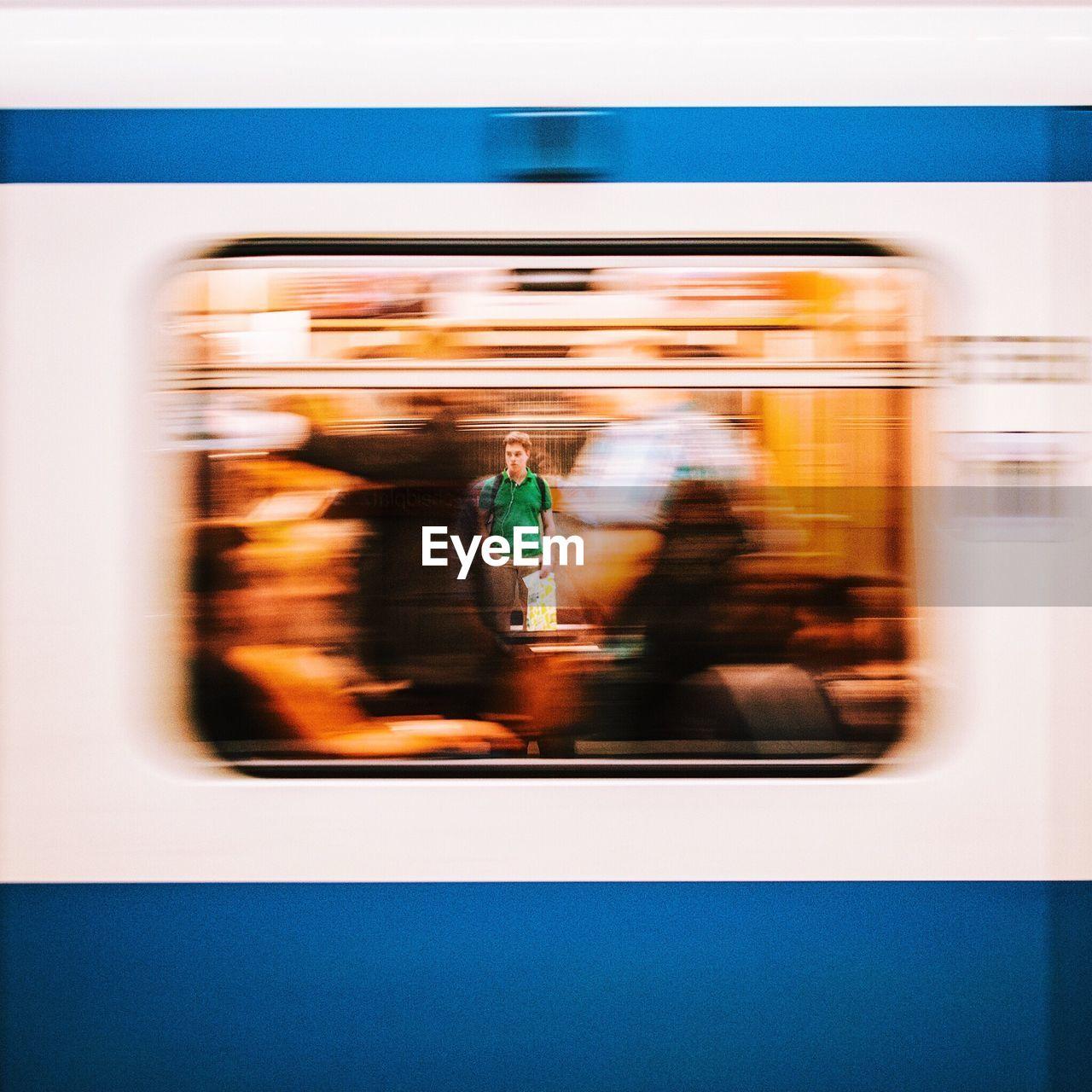transportation, mode of transport, blurred motion, train - vehicle, land vehicle, metro train, public transportation, passenger train, motion, real people, speed, journey, men, day, outdoors