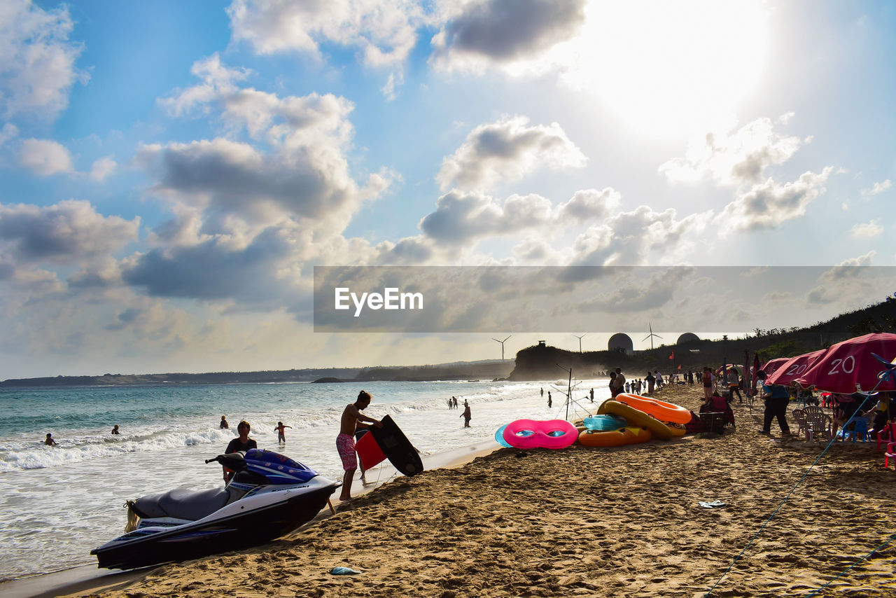 sky, water, cloud - sky, beach, sea, land, nautical vessel, real people, sand, nature, group of people, transportation, lifestyles, leisure activity, men, day, mode of transportation, horizon over water, beauty in nature, outdoors