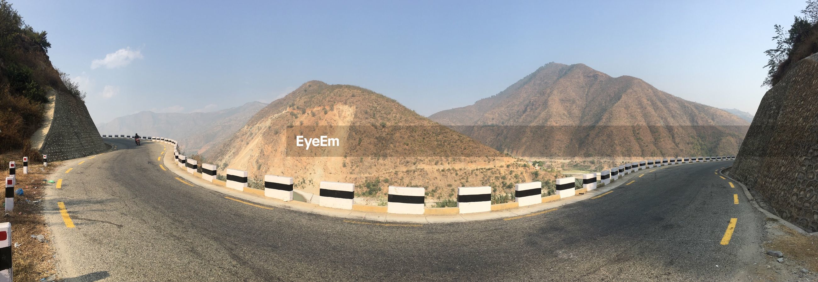 PANORAMIC VIEW OF ROAD LEADING TOWARDS MOUNTAIN