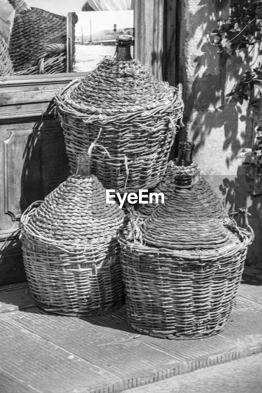 High angle view of wicker baskets on sidewalk