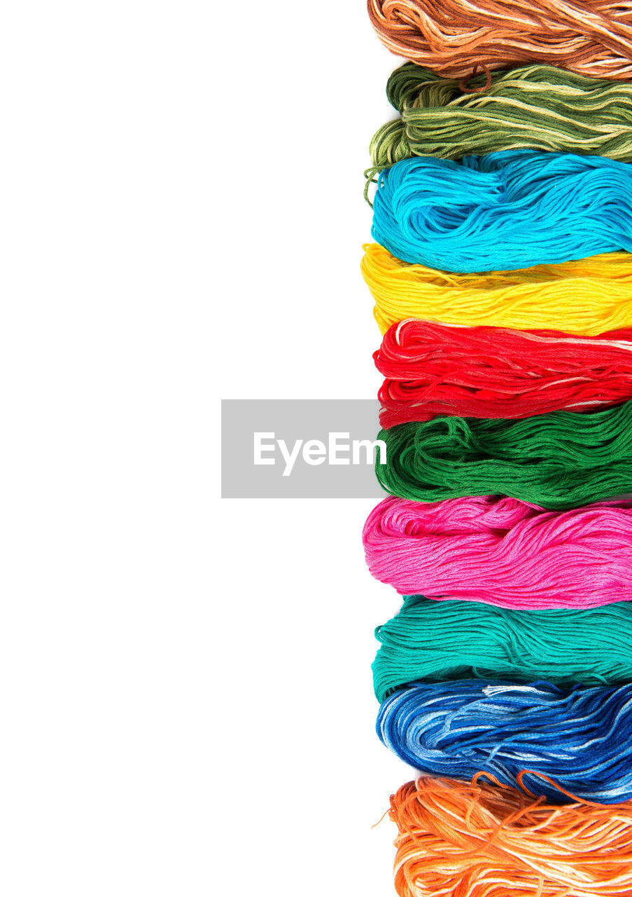 multi colored, white background, copy space, studio shot, wool, textile, no people, close-up