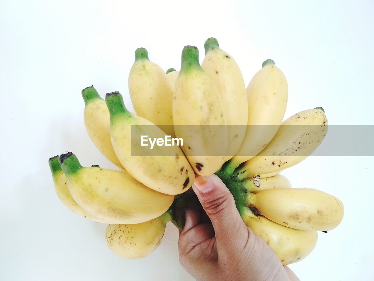 fruit, banana, healthy eating, food and drink, food, human hand, white background, freshness, holding, studio shot, human body part, ripe, banana peel, healthy lifestyle, one person, pitaya, lifestyles, close-up, day, people