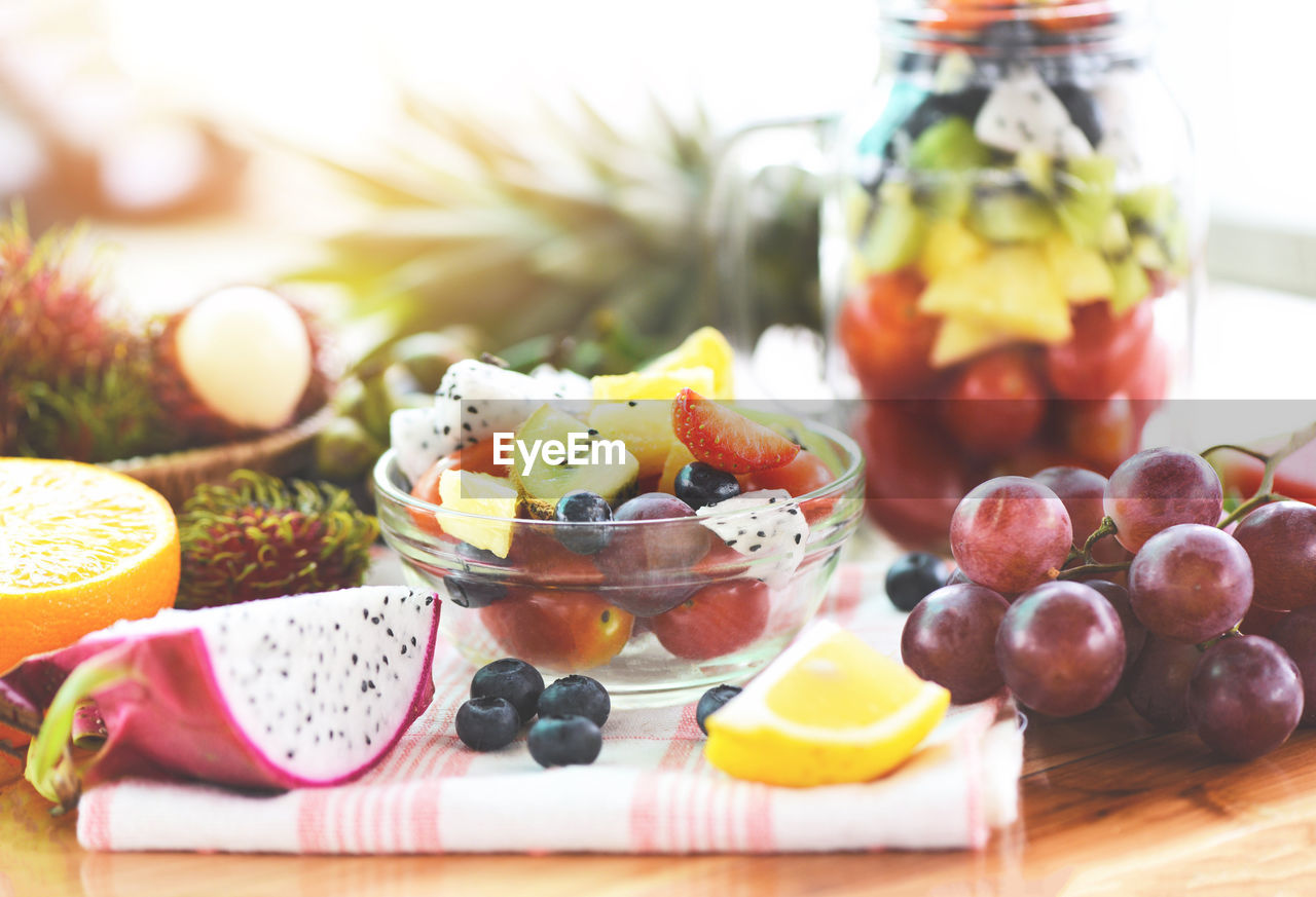 food and drink, food, fruit, healthy eating, freshness, wellbeing, table, grape, no people, choice, selective focus, variation, vegetable, still life, berry fruit, indoors, ready-to-eat, glass - material, close-up, container, temptation, fruit salad