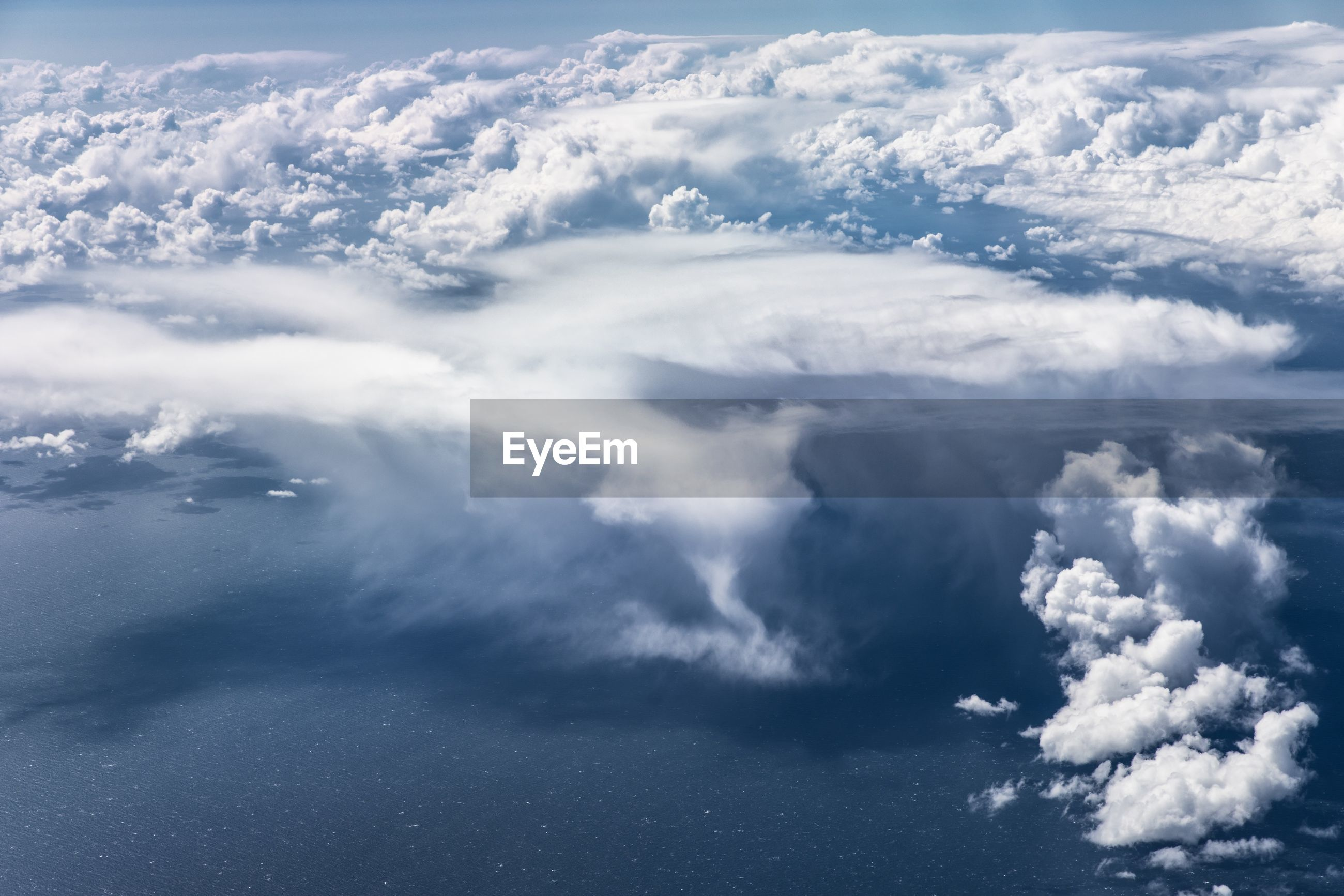 AERIAL VIEW OF CLOUDSCAPE OVER SEA