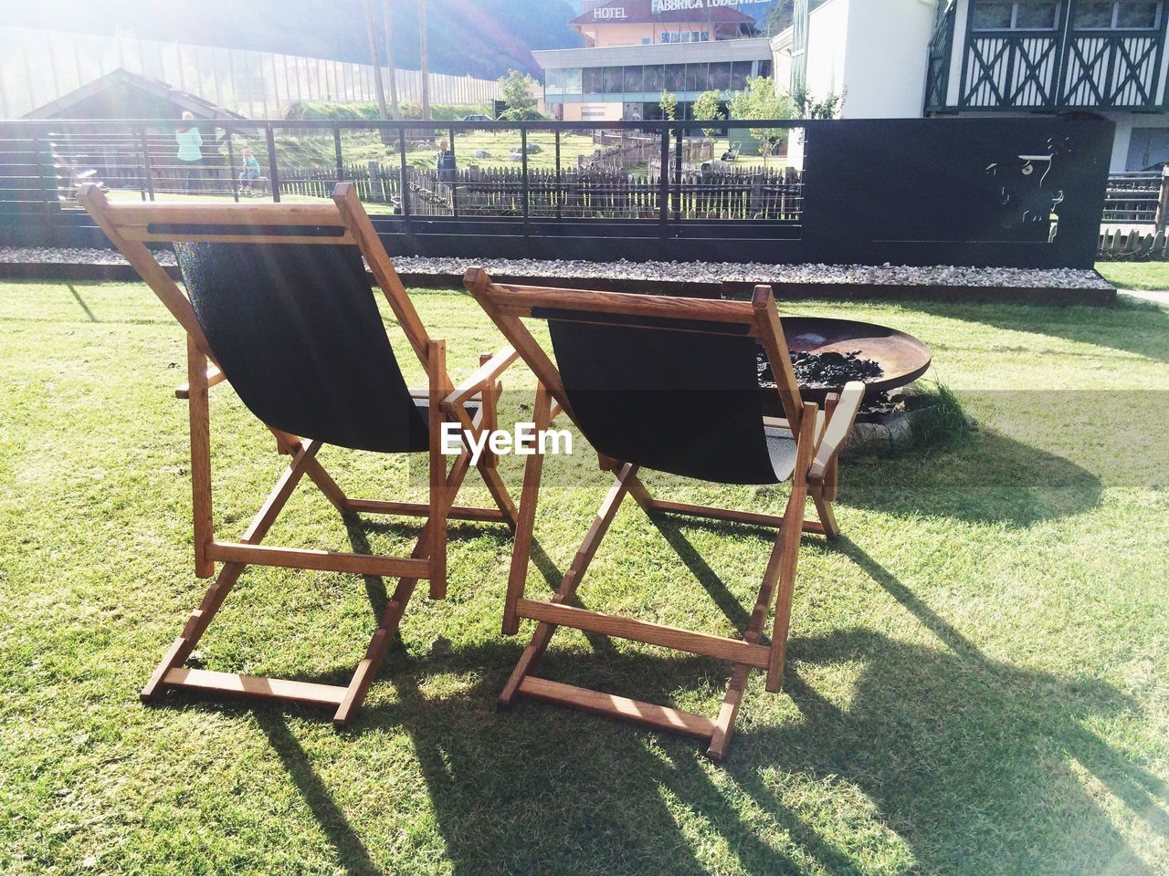 chair, table, day, sunlight, no people, grass, architecture, built structure, shadow, outdoors, building exterior, nature, seat, tree