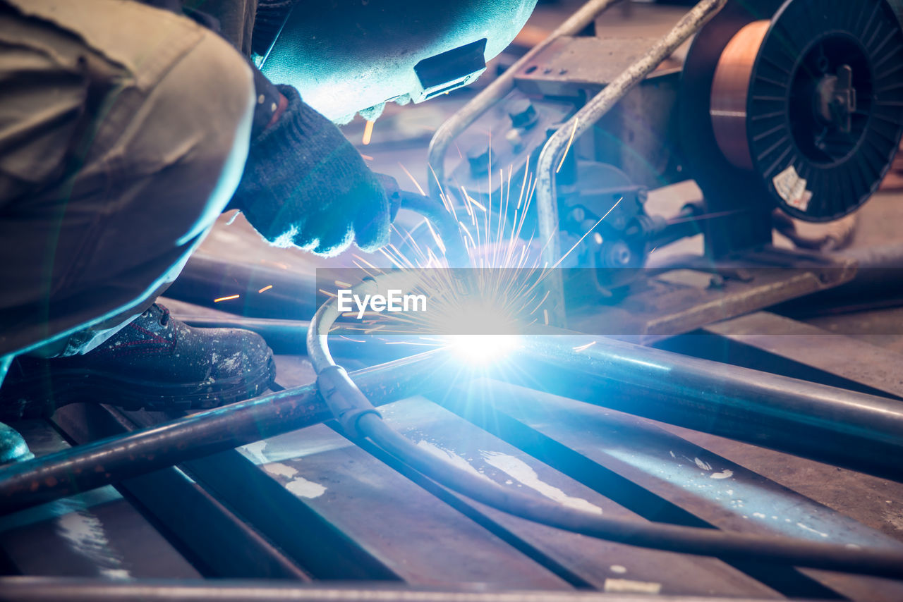 Low angle view of man welding in factory