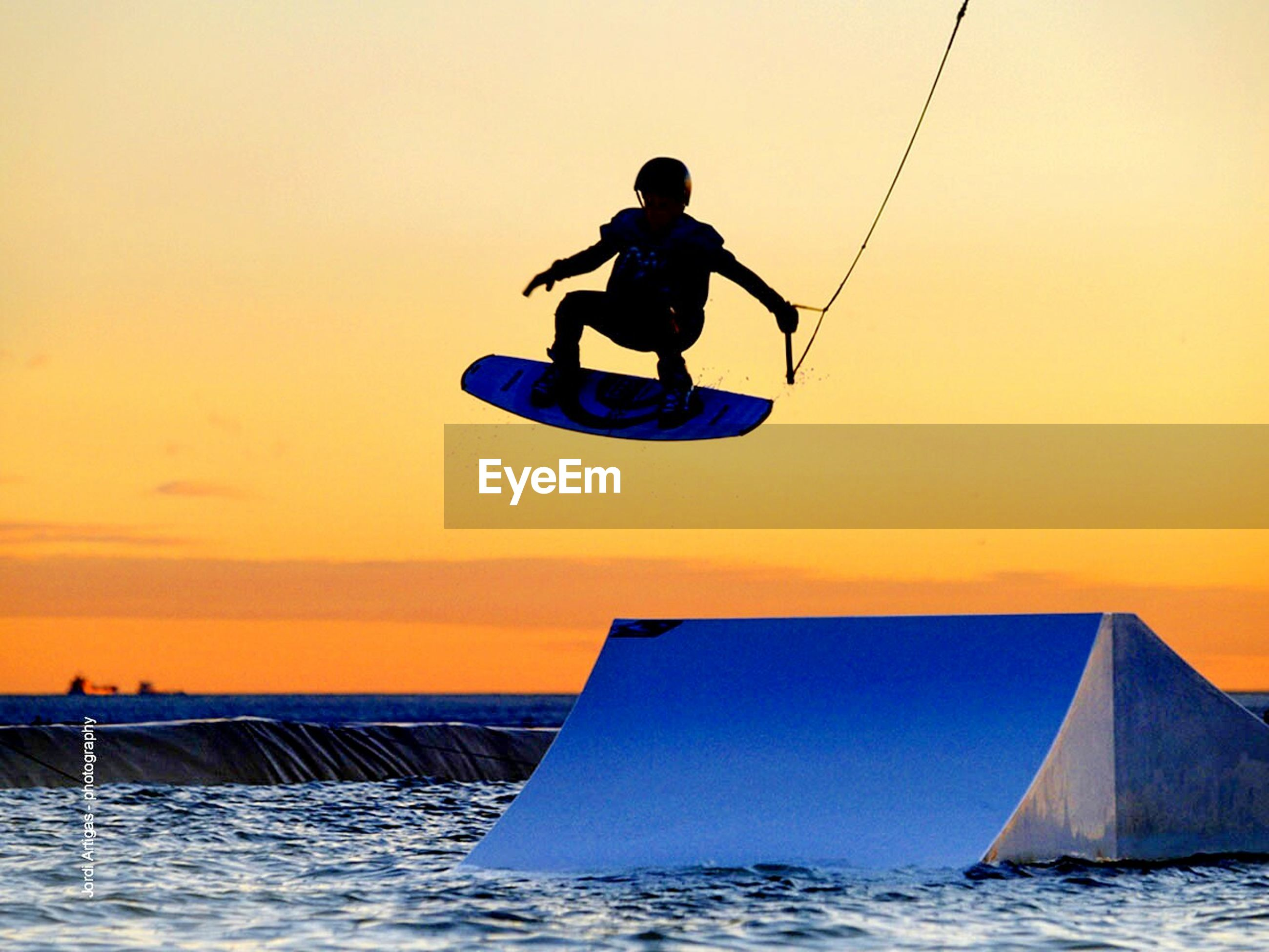 men, leisure activity, lifestyles, water, full length, sea, waterfront, sky, silhouette, transportation, nautical vessel, sunset, clear sky, extreme sports, adventure, mode of transport, vacations