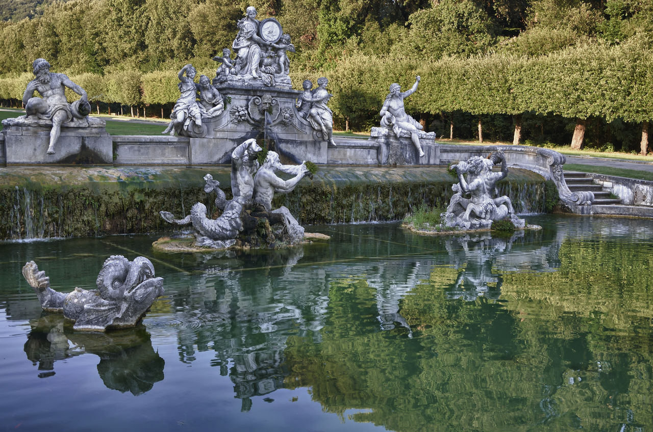 water, reflection, lake, sculpture, statue, day, representation, art and craft, human representation, nature, architecture, plant, tree, waterfront, male likeness, history, the past, fountain, no people, outdoors