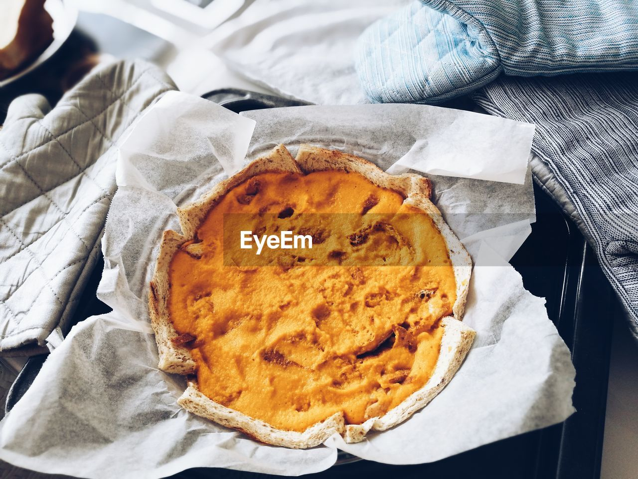 High angle view of pumpkin pie in container on table
