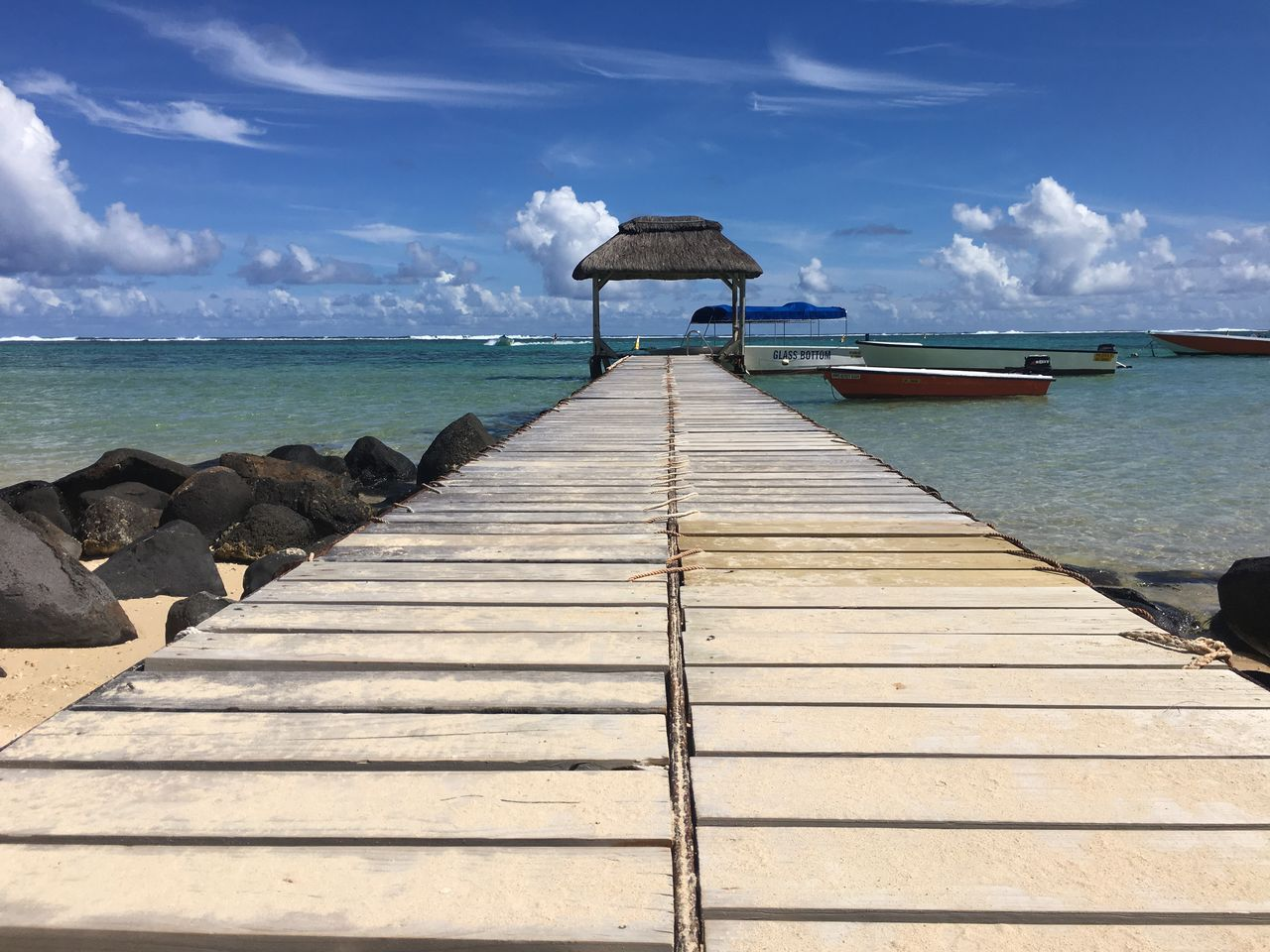 water, sea, sky, horizon over water, horizon, cloud - sky, scenics - nature, beauty in nature, direction, the way forward, nature, tranquil scene, pier, tranquility, wood - material, day, no people, jetty, sunlight, outdoors, wood, wood paneling