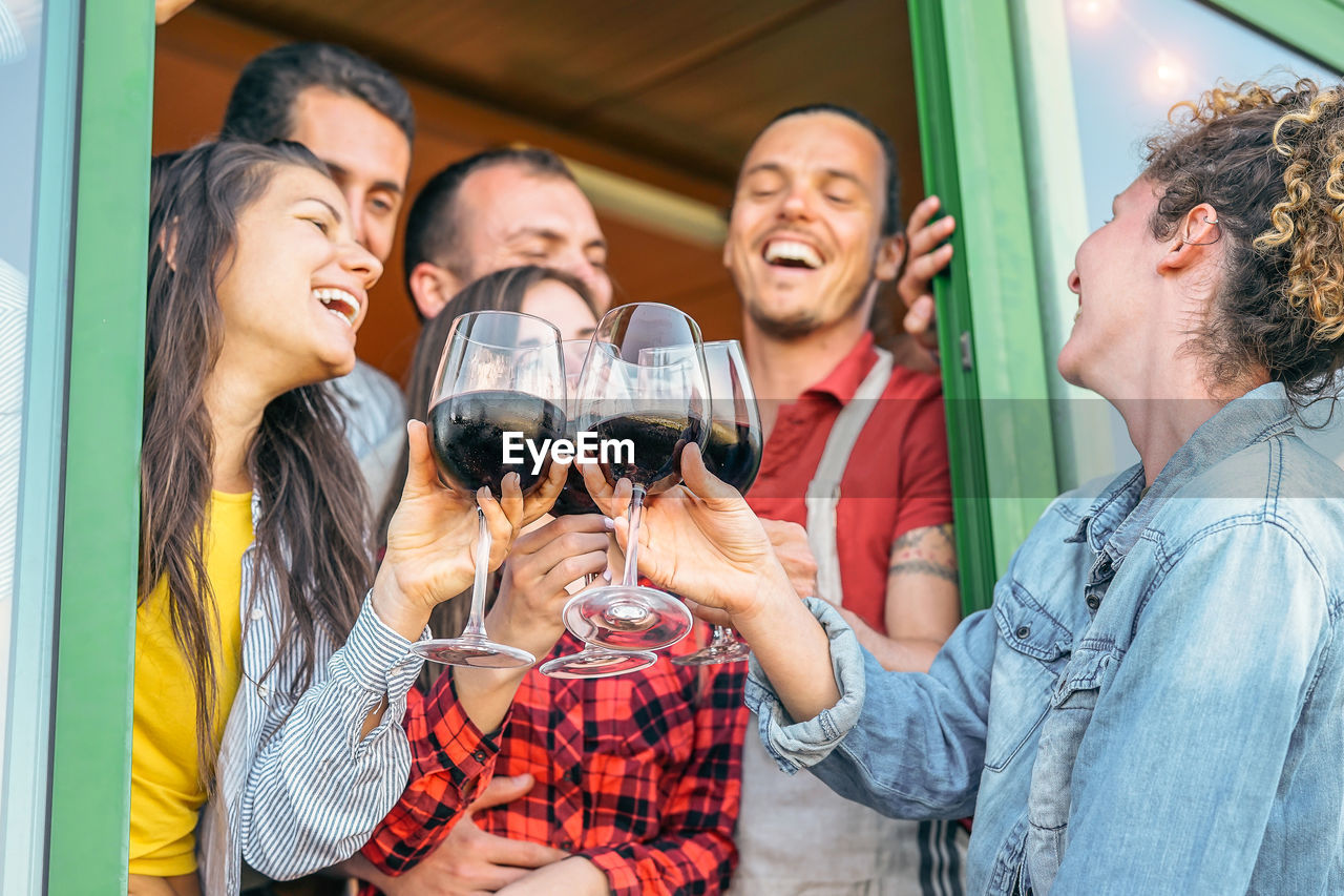 alcohol, togetherness, drink, smiling, refreshment, happiness, group of people, women, men, emotion, young women, food and drink, celebration, young adult, casual clothing, leisure activity, friendship, lifestyles, adult, drinking, glass, positive emotion, celebratory toast, couple - relationship