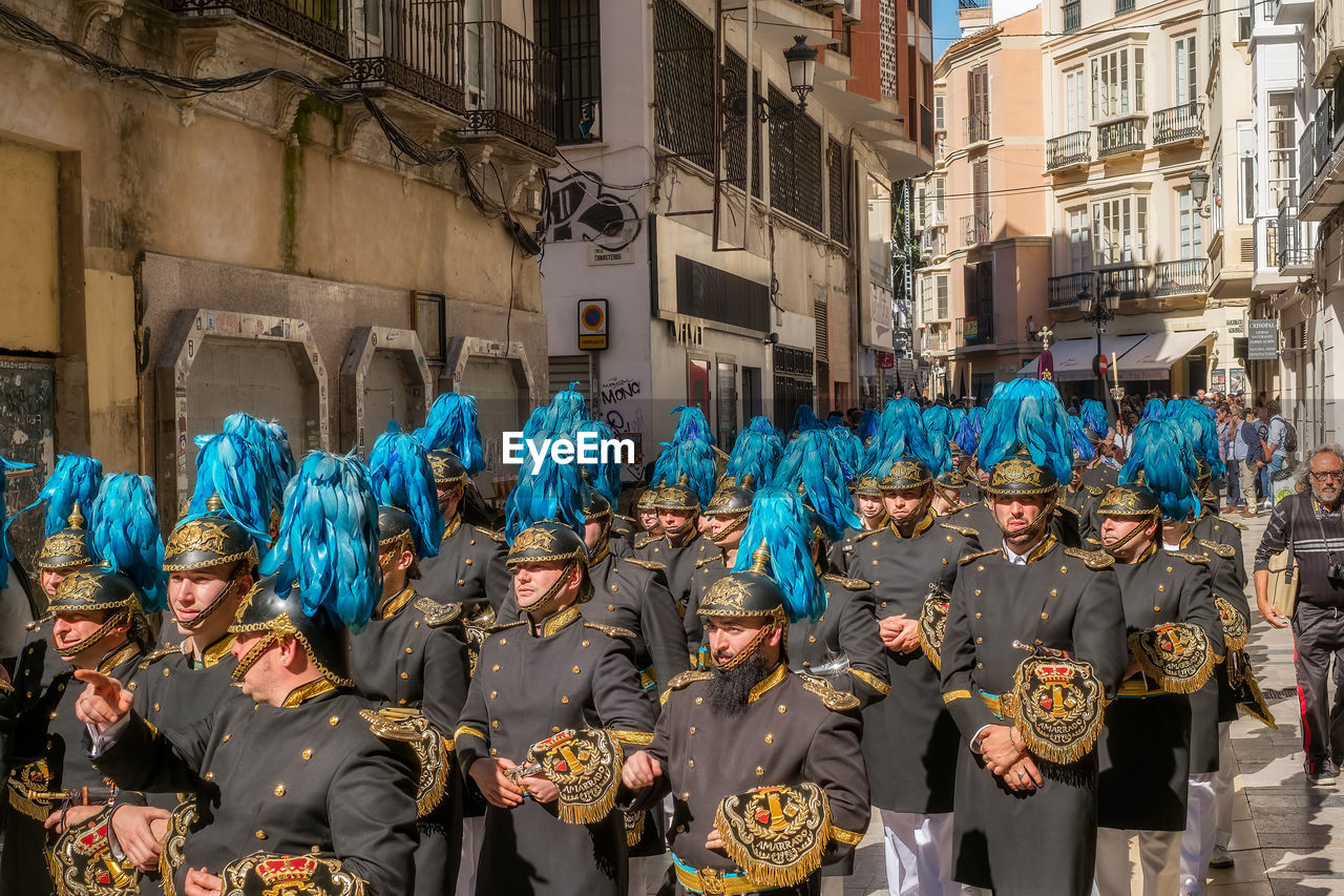real people, group of people, architecture, large group of people, building exterior, city, crowd, men, standing, women, lifestyles, built structure, day, celebration, street, costume, leisure activity, togetherness, clothing, outdoors, carnival - celebration event, festival