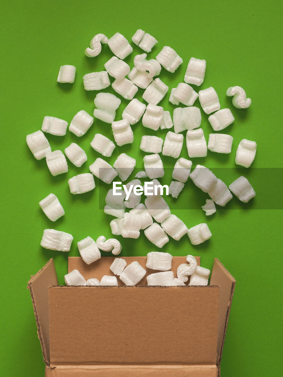 large group of objects, indoors, container, still life, studio shot, colored background, green background, no people, white color, box, green color, close-up, medicine, abundance, box - container, cardboard box, cardboard, brown, polystyrene, healthcare and medicine, package, sugar cube