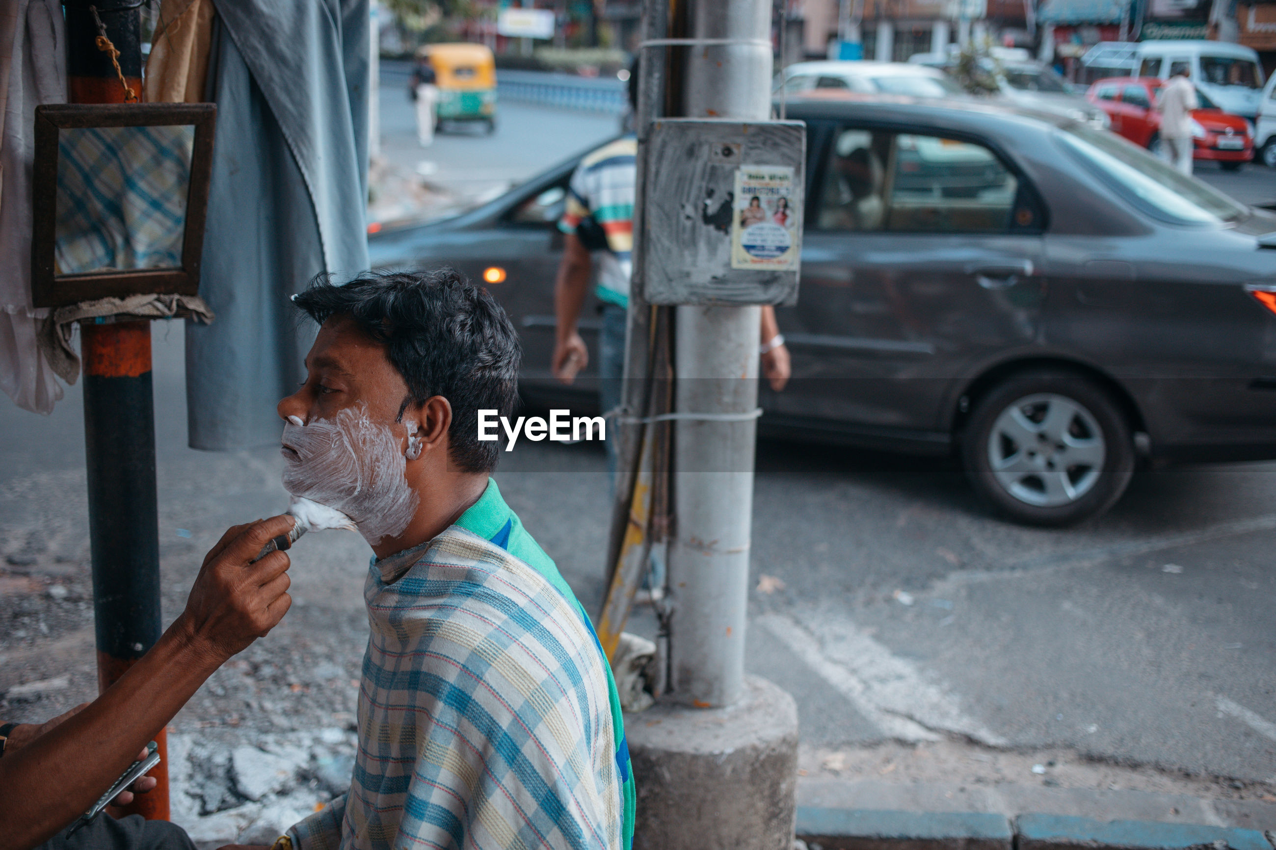 MAN WORKING IN STREET
