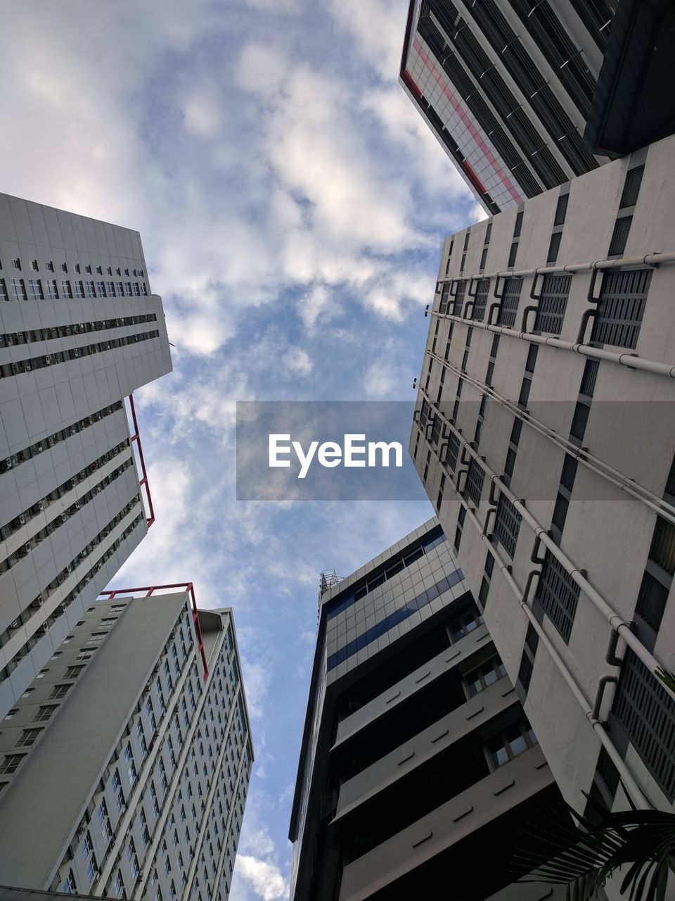 building exterior, architecture, sky, cloud - sky, building, low angle view, built structure, city, office, nature, day, office building exterior, no people, residential district, tall - high, modern, outdoors, city life, tower, skyscraper, directly below, apartment, financial district