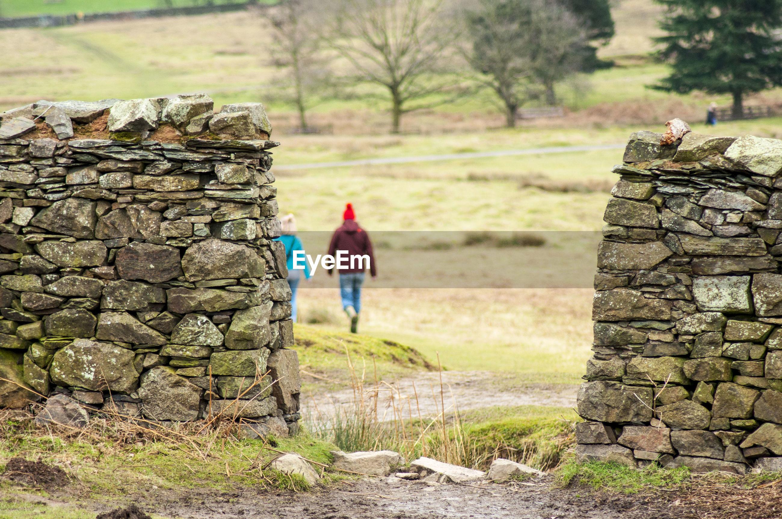 Retaining stone wall on field