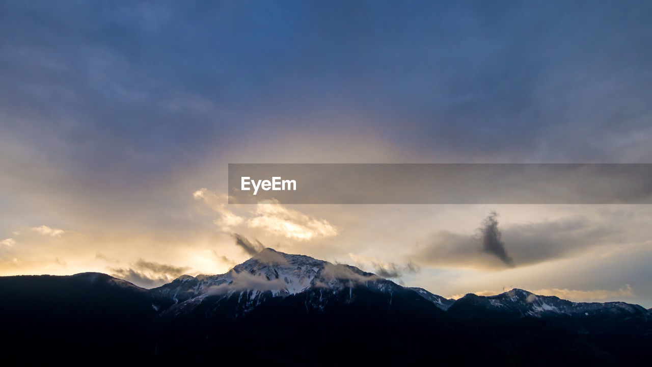 mountain, snow, beauty in nature, nature, cold temperature, winter, scenics, tranquility, weather, tranquil scene, sunset, sky, mountain range, cloud - sky, snowcapped mountain, no people, outdoors, landscape, day