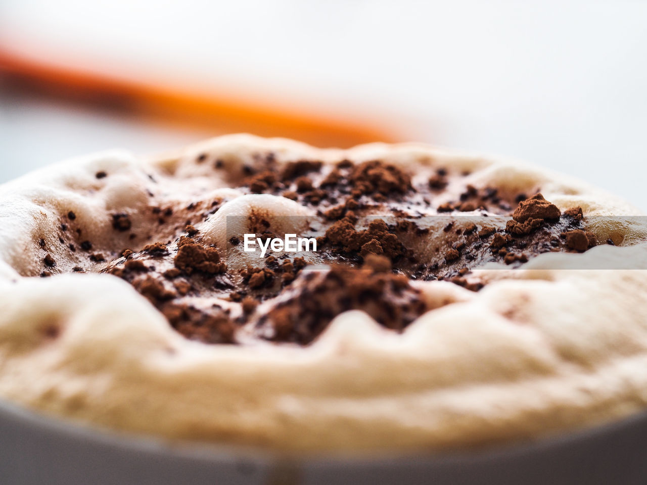 Close-Up Of Chocolate Cocoa Powder On Froth In Coffee At Cafe