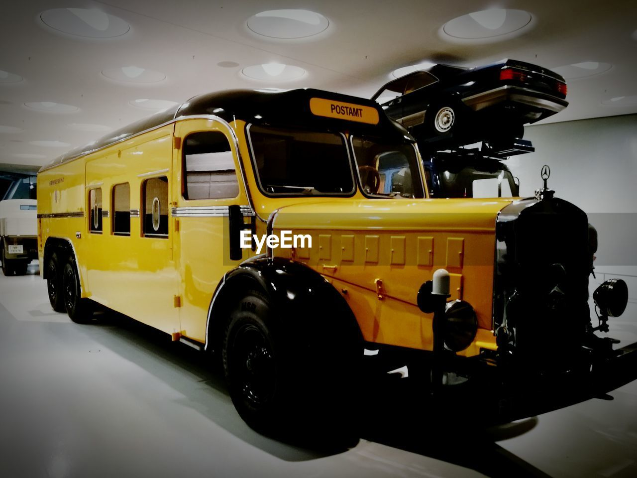 yellow, land vehicle, transportation, mode of transport, stationary, no people, bus, indoors, day, close-up
