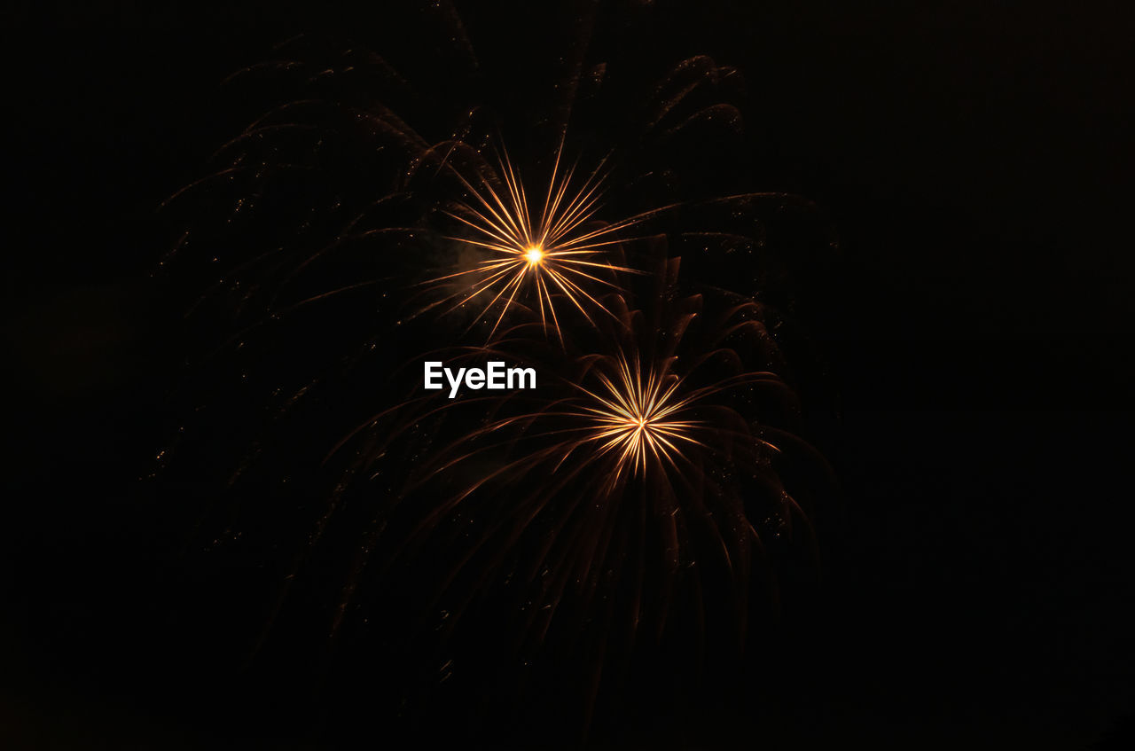firework, night, illuminated, firework display, arts culture and entertainment, celebration, event, exploding, motion, glowing, long exposure, low angle view, no people, firework - man made object, sky, light, nature, blurred motion, copy space, dark, sparks