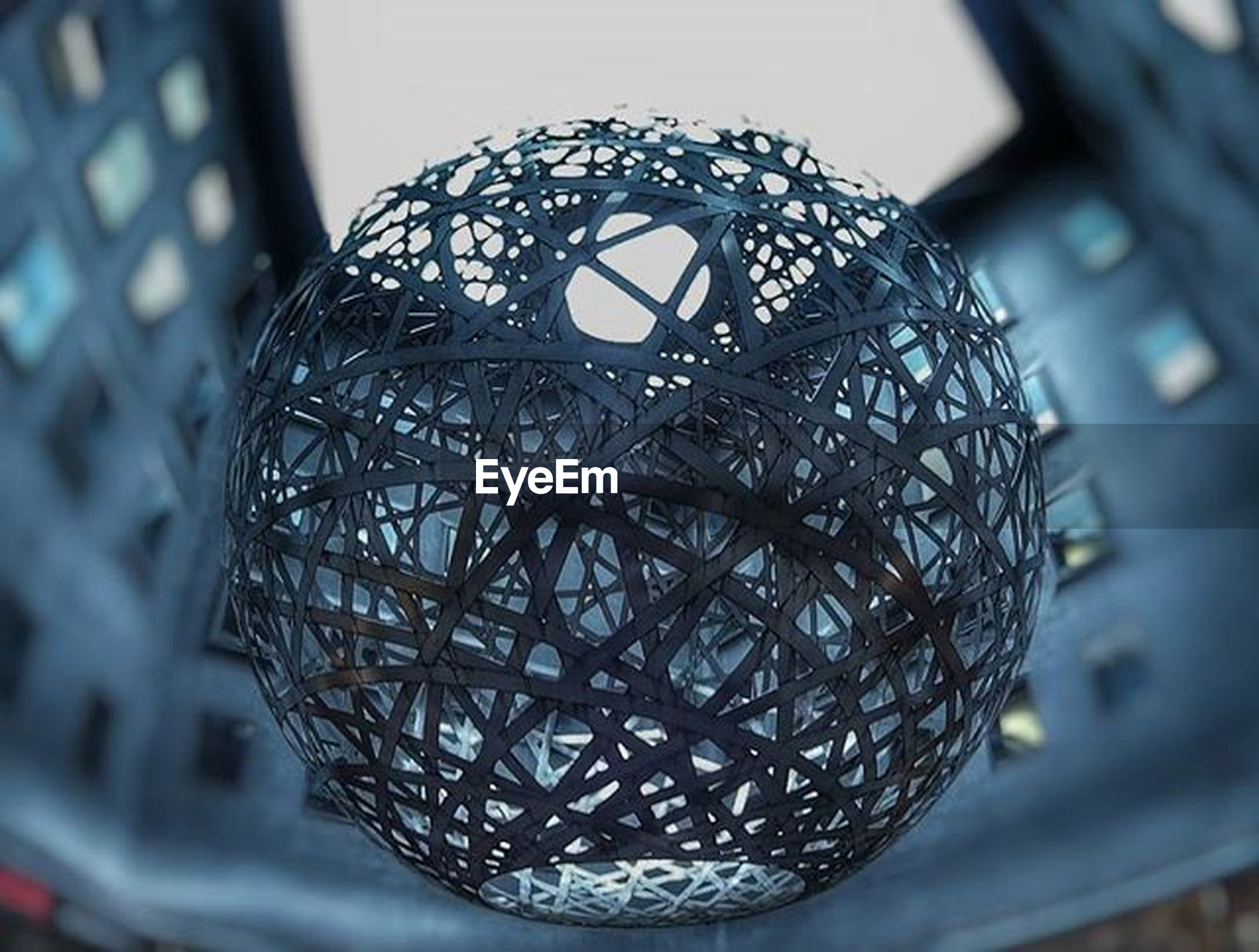 close-up, focus on foreground, indoors, pattern, metal, design, decoration, hanging, no people, glass - material, selective focus, metallic, low angle view, day, lighting equipment, reflection, sphere, transparent, built structure