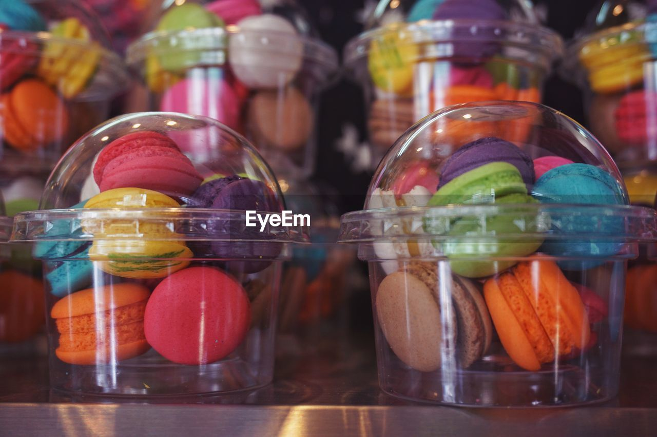 glass - material, food and drink, food, jar, transparent, container, freshness, indoors, still life, close-up, multi colored, sweet food, no people, choice, variation, candy, table, healthy eating, focus on foreground, for sale, glass, temptation